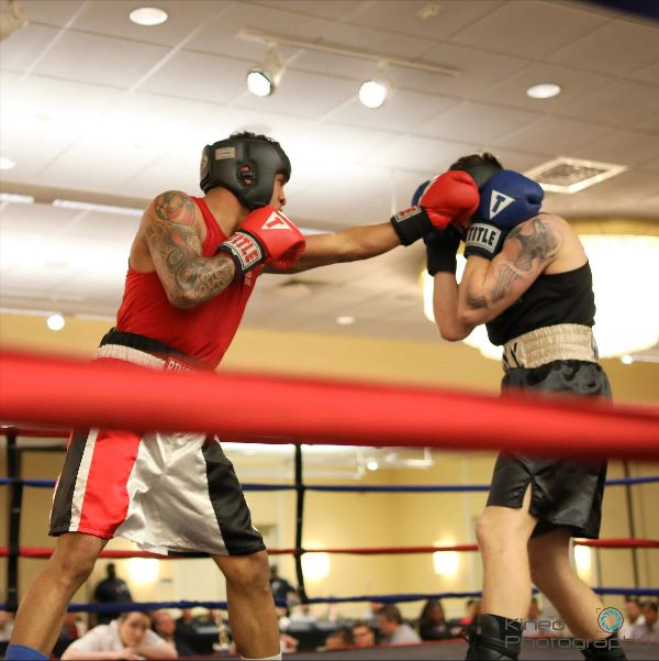 "Portland Boxing Club's Josniel Castro, left, and West Point's Luca Botis, right, at the Lawrence Exchange Club Charity Fight Night on April 20, 2019. Castro won by a 4-1 majority decision and was also awarded the ""Outstanding Boxer of the Night"" award. Photo courtesy Kineo Photography."
