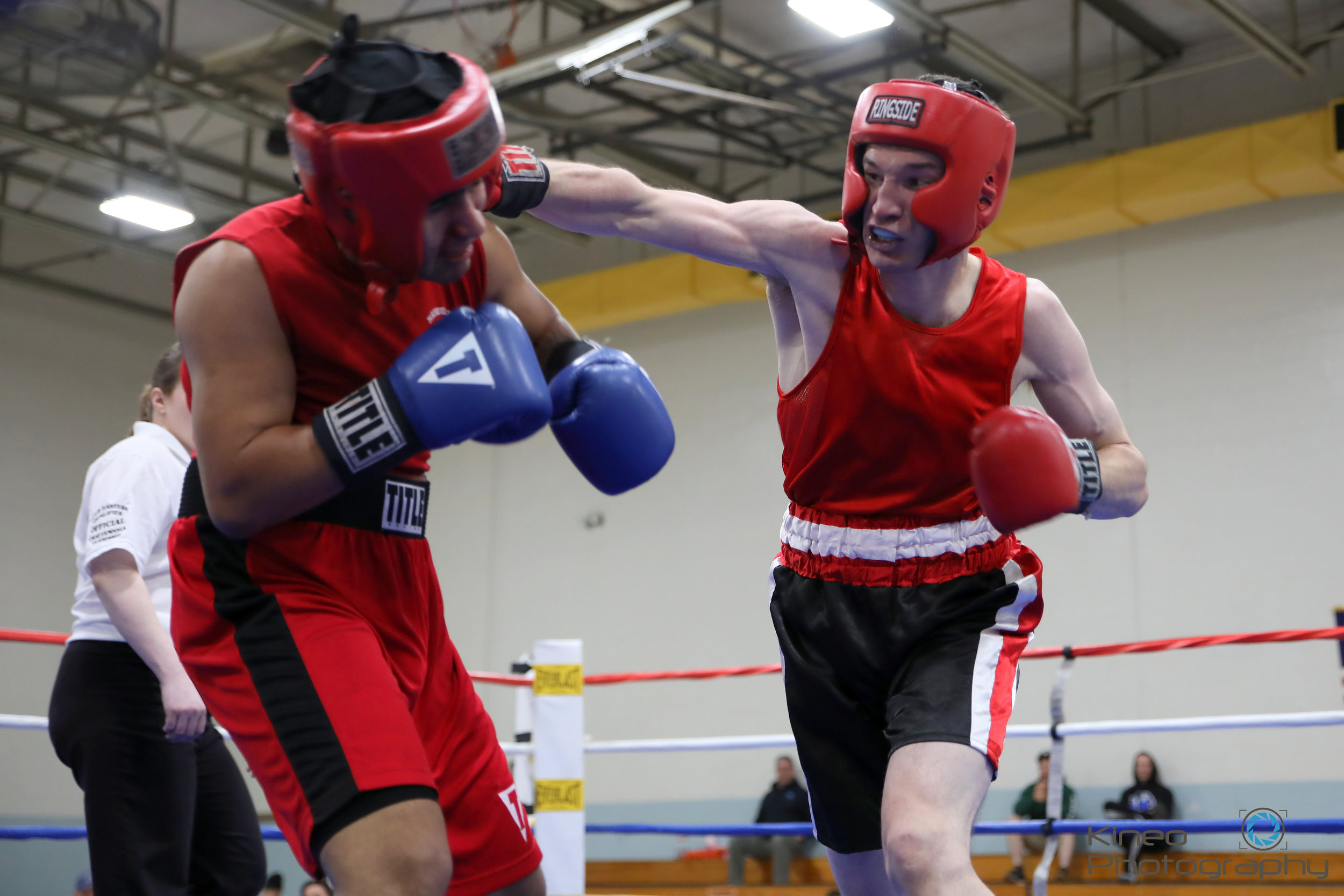 Portland Boxing Club's Alec Dacar (right) connects with Estevan Hincapie at Lewiston Fight Night on May 25, 2019.