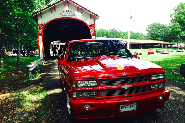 Red Chevy at covered bridge