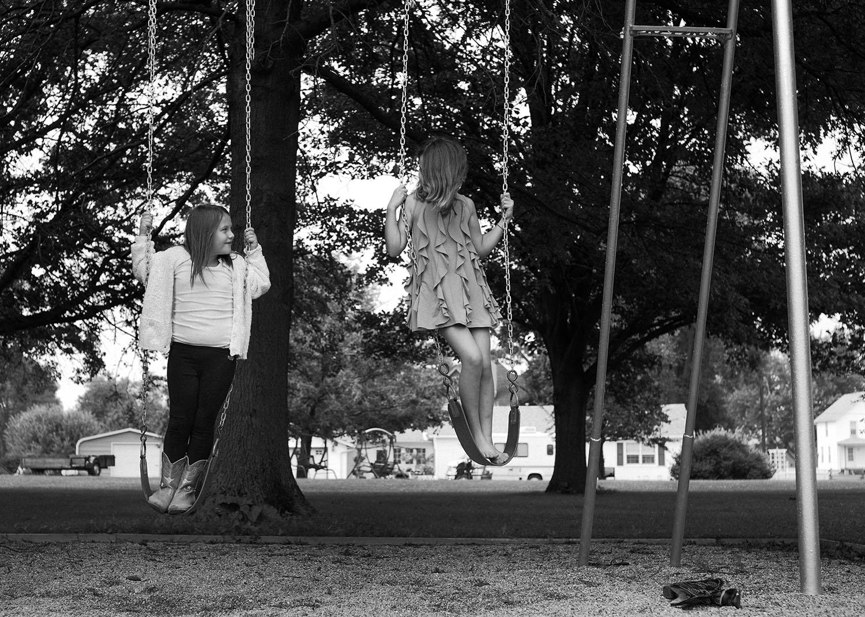 girls on swingset