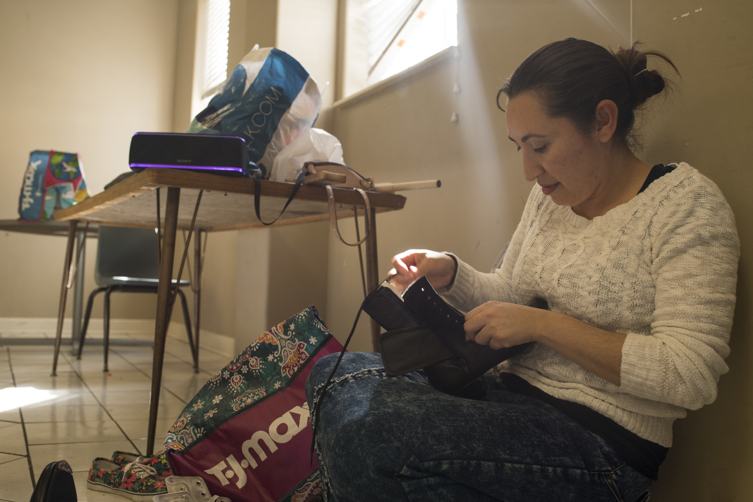 Elisabet Valadez, an instructor and choreographer of several Cinco de Mayo festival dances, laces a pair of Mexican  adelita folklorico  boots - leather heeled boots with nails on the tip of the toe used to create a unique sound while dancing.