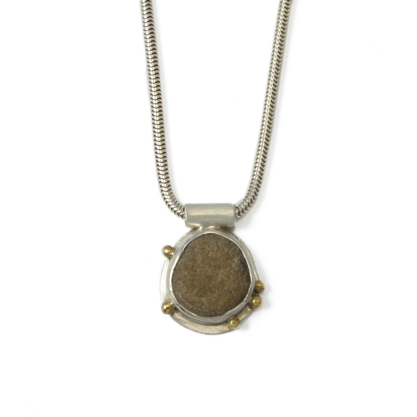JN brown stone granuals pend EDITED.jpg