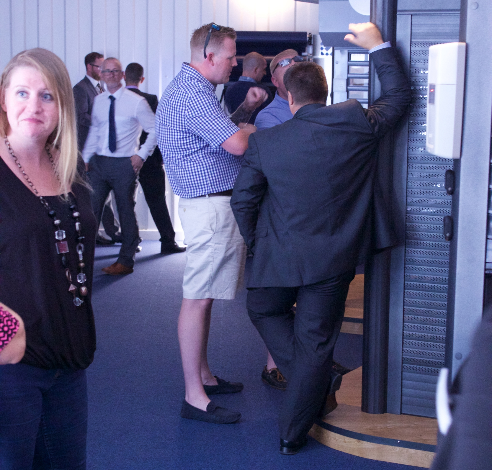 Guests discuss the latest Roller Shutter technology with the suppliers in the Aluroll Showroom
