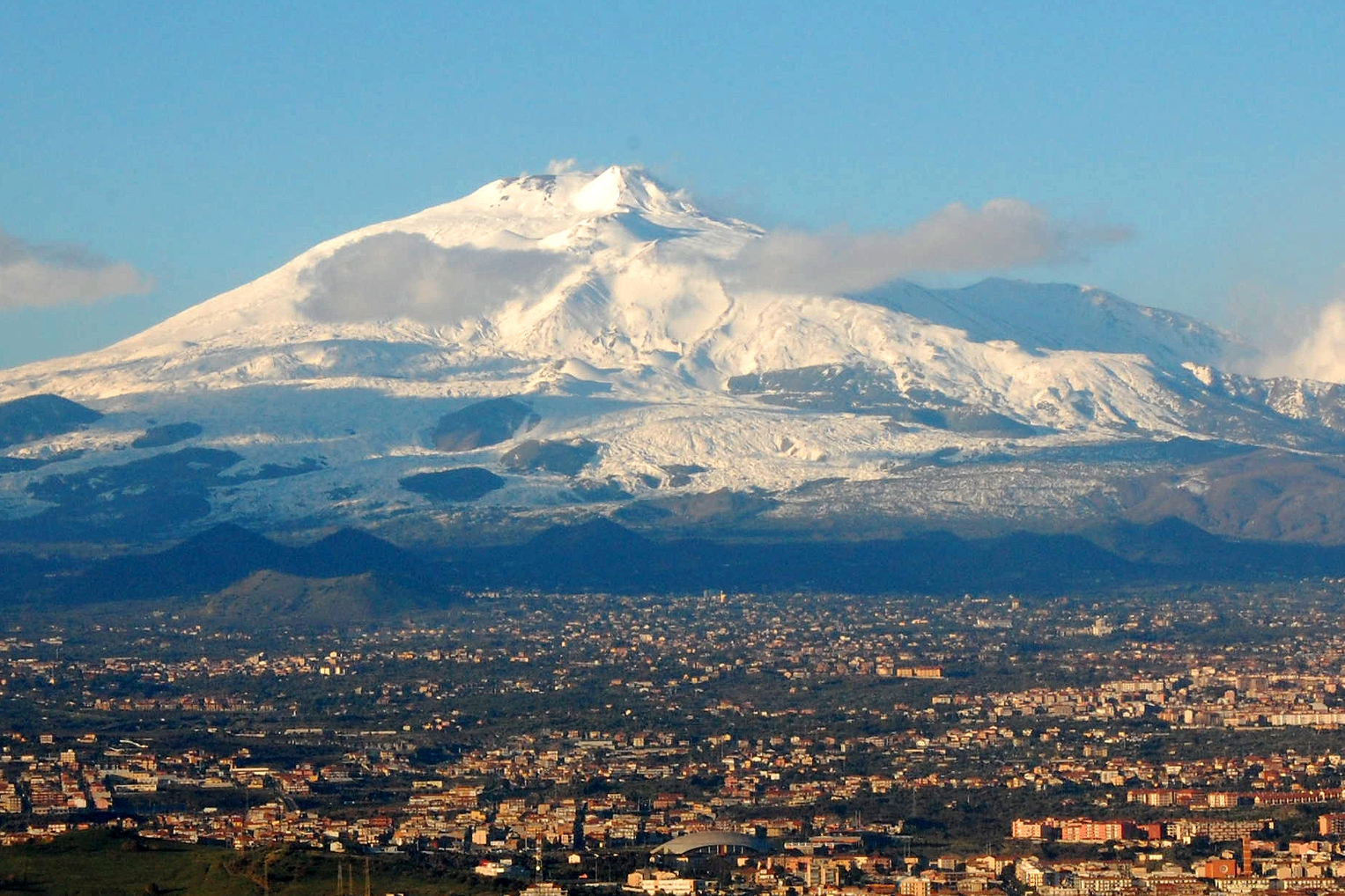 Mt. Etna looming over Catania