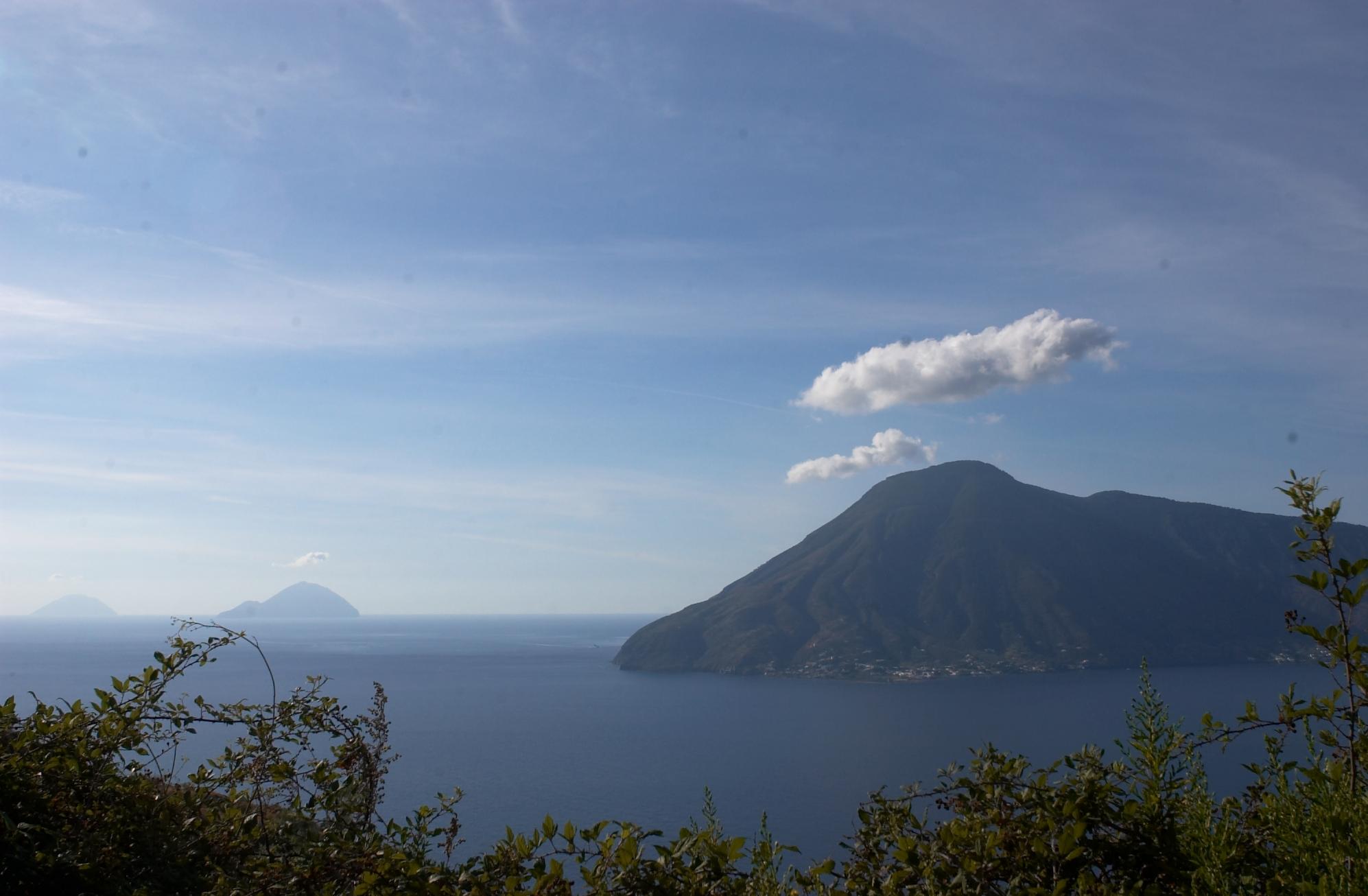 Salina Island, as seen from Lipari. Filicudi and Alicudi islands in the background. (Aeolian Islands)