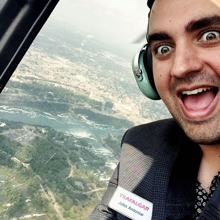 John, ITMI Alumni 2013, having a blast seeing Niagara Falls from a helicopter with Trafalgar