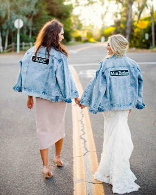 [SOURCE: Martha Stewart Weddings]  Wearing a denim jacket with a bridal gown may seem strange, but it's a growing trend that a lot of brides are using for their weddings. Styles range from road trip-inspired designs to western and rustic themes. In fact,  Pretty Me notes that a denim jacket can be thrown over a maxi dress  or skirt if you want the finished look to be less formal. You can even add your own touch of embellishments to customize them.  Martha Stewart Weddings details how denim jackets can be easily customized  to include patches. This adds a personal touch that will make your wedding even more special.  Layered Lace and Strappy Shoes