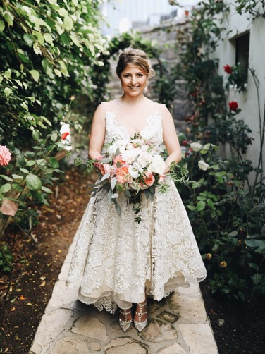 We absolutely fell in love with  body-positive blogger Laurie Brucker when she wore the L'ezu bridal gown  that incorporates a short front and a longer train in the back. The short dress perfectly highlighted her lovely strappy Valentino shoes that complimented her entire look.  There are so many other ways to 'rebel' against the traditional wedding looks and themes. For one, you don't have to choose white for your wedding gown and your motif can include non-traditional colors like black. It all boils down to the little details that tie all the big elements together. If you want some more wedding ideas be sure to check out  the different designs at L'ezu Bridal Atelier.   Article by: Caroline Diners