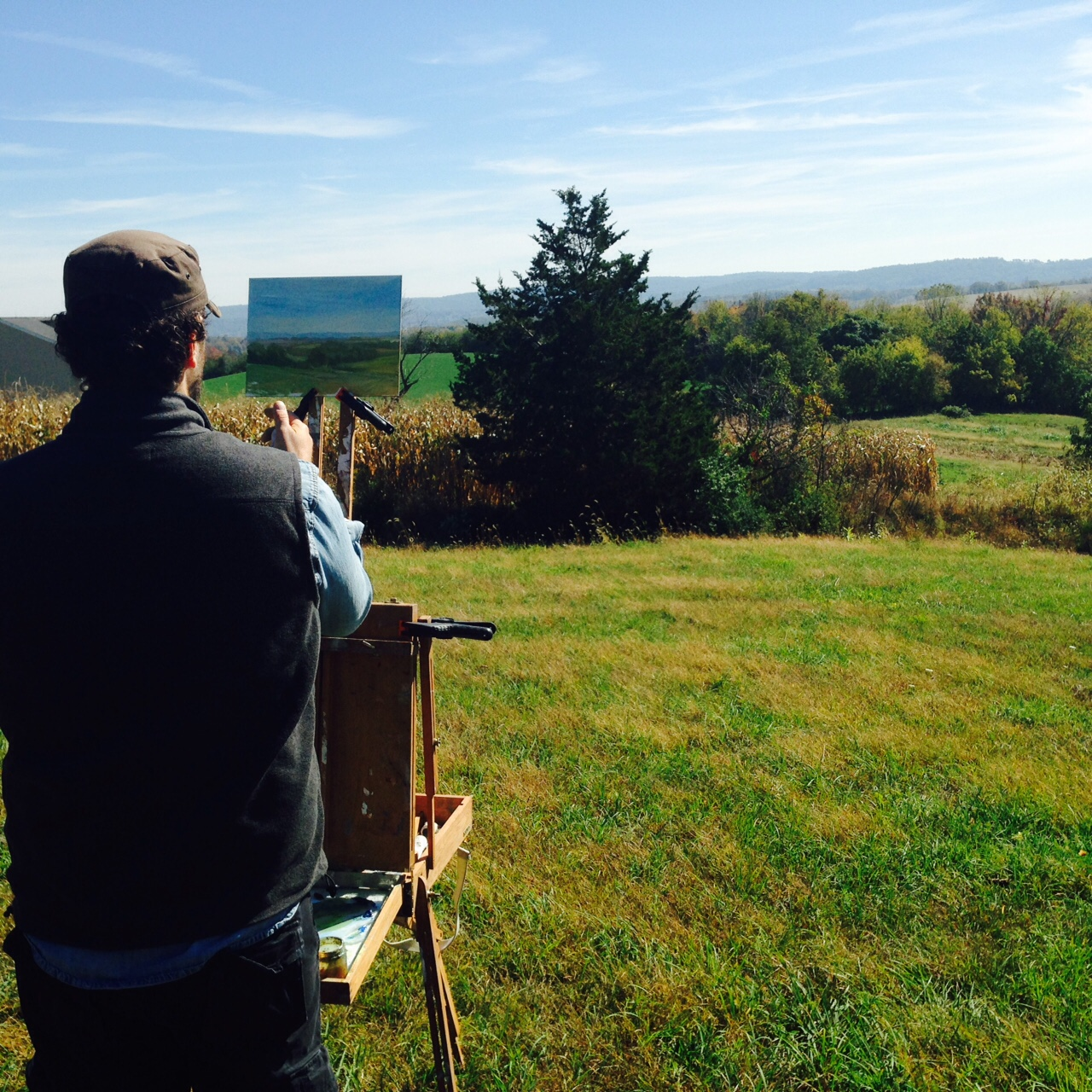 Adriano, painting the distant hills from our perch on top of the world at Clear Spring Farm.