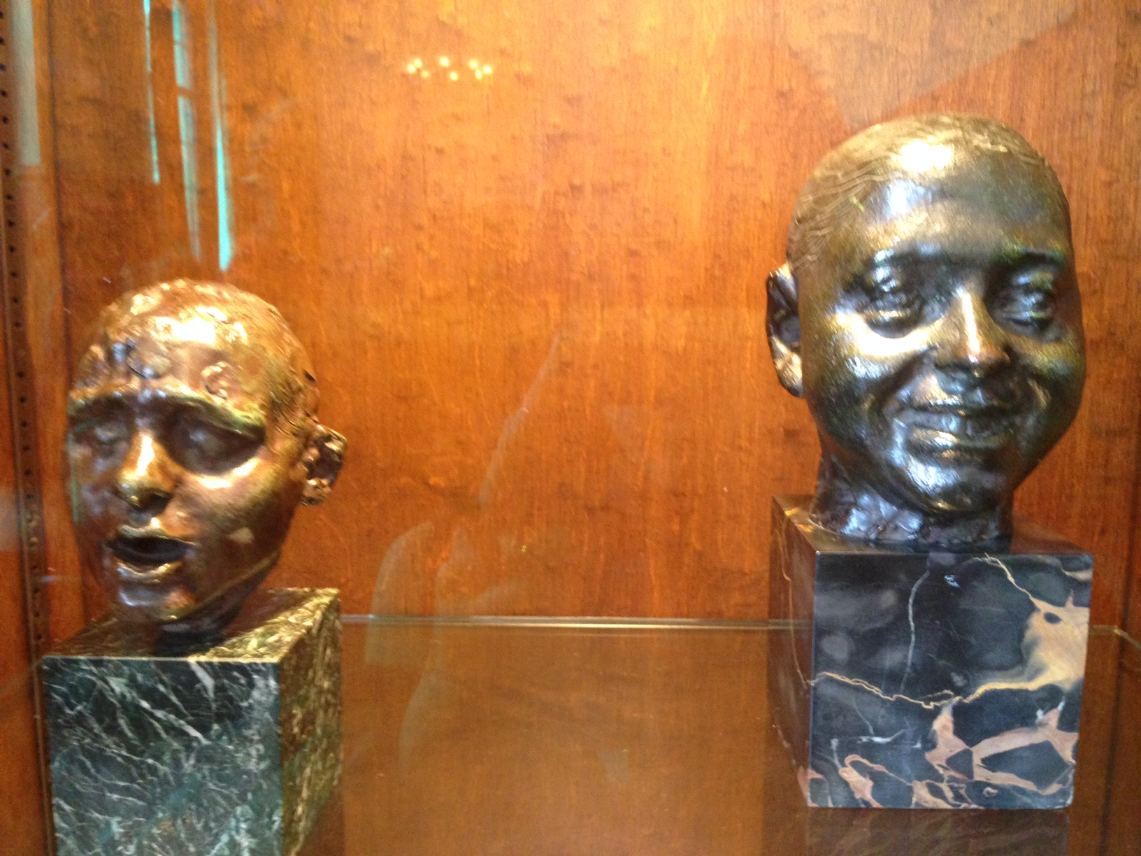 """Head of a Slave"" and ""Laughing Boy"" by Camille Claudel"