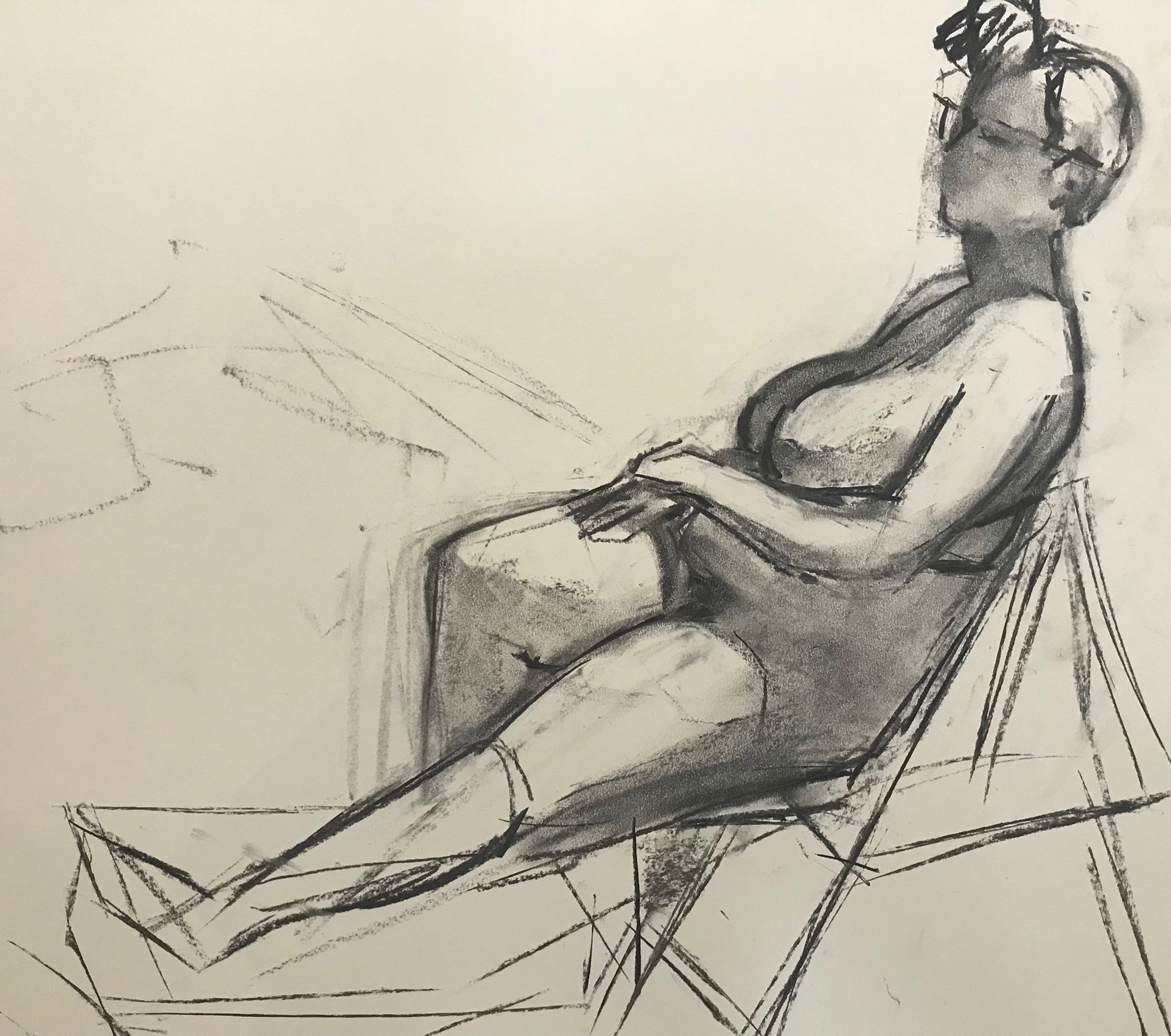 Figure reclining in a chair (2), charcoal on paper, 18x24 inches (my drawing)