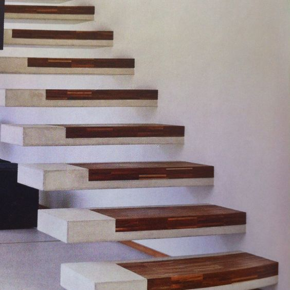 Floating concrete treads with timber inlay. Designer unknown.