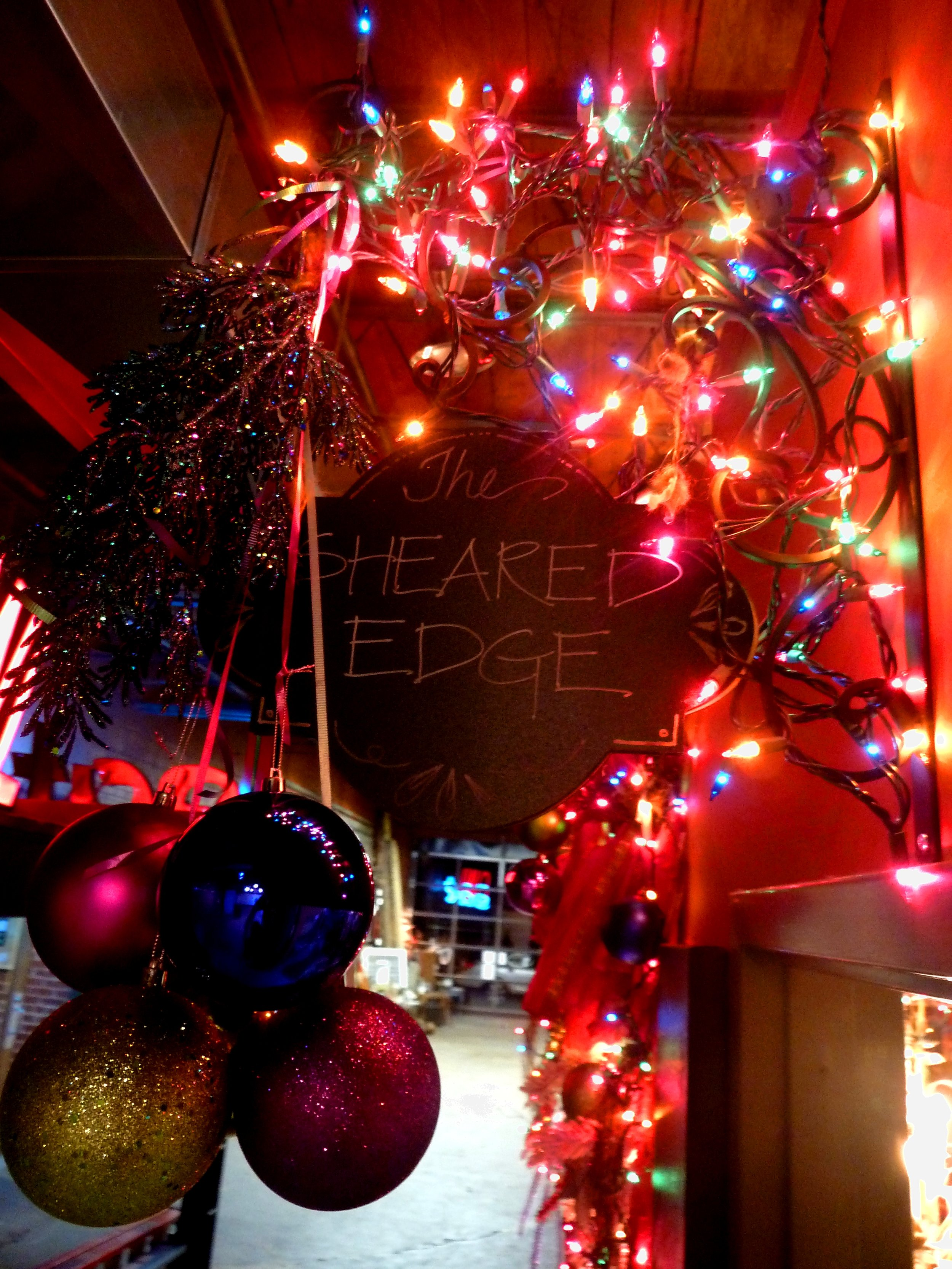 This festive sign at The Studios on Sheridan will direct your path to The Sheared Edge!