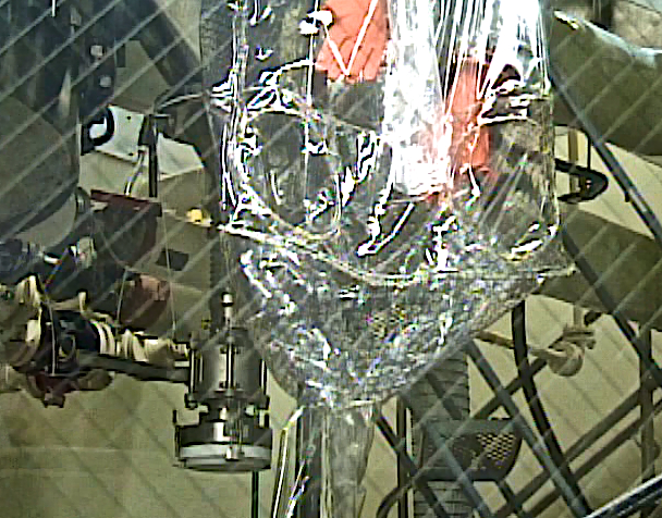 Containment Surrounding the Sample Port of a Filter/Dryer