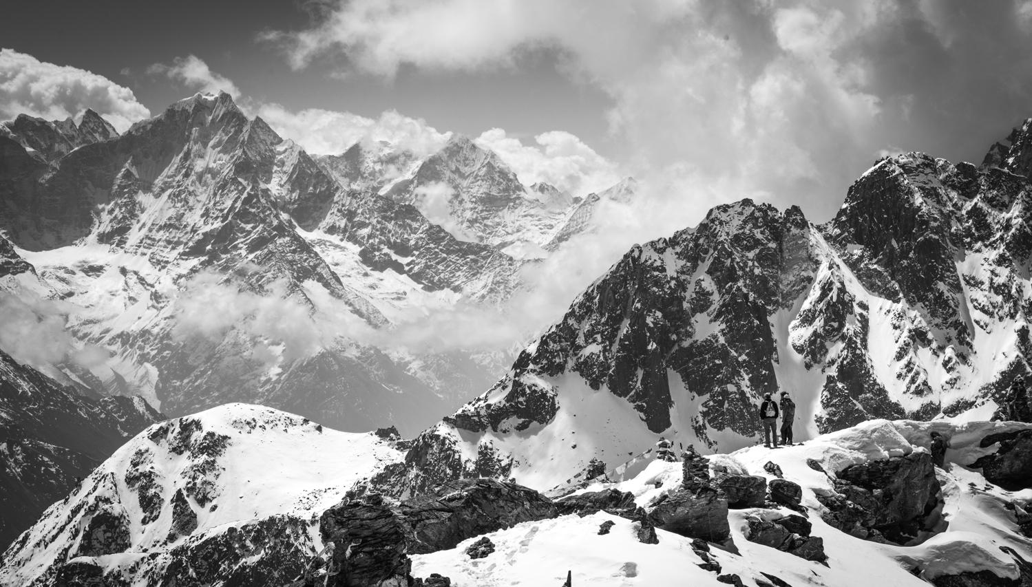 Tourists enjoy views on top of Gokyo Ri - Khumbu Region, Nepal.