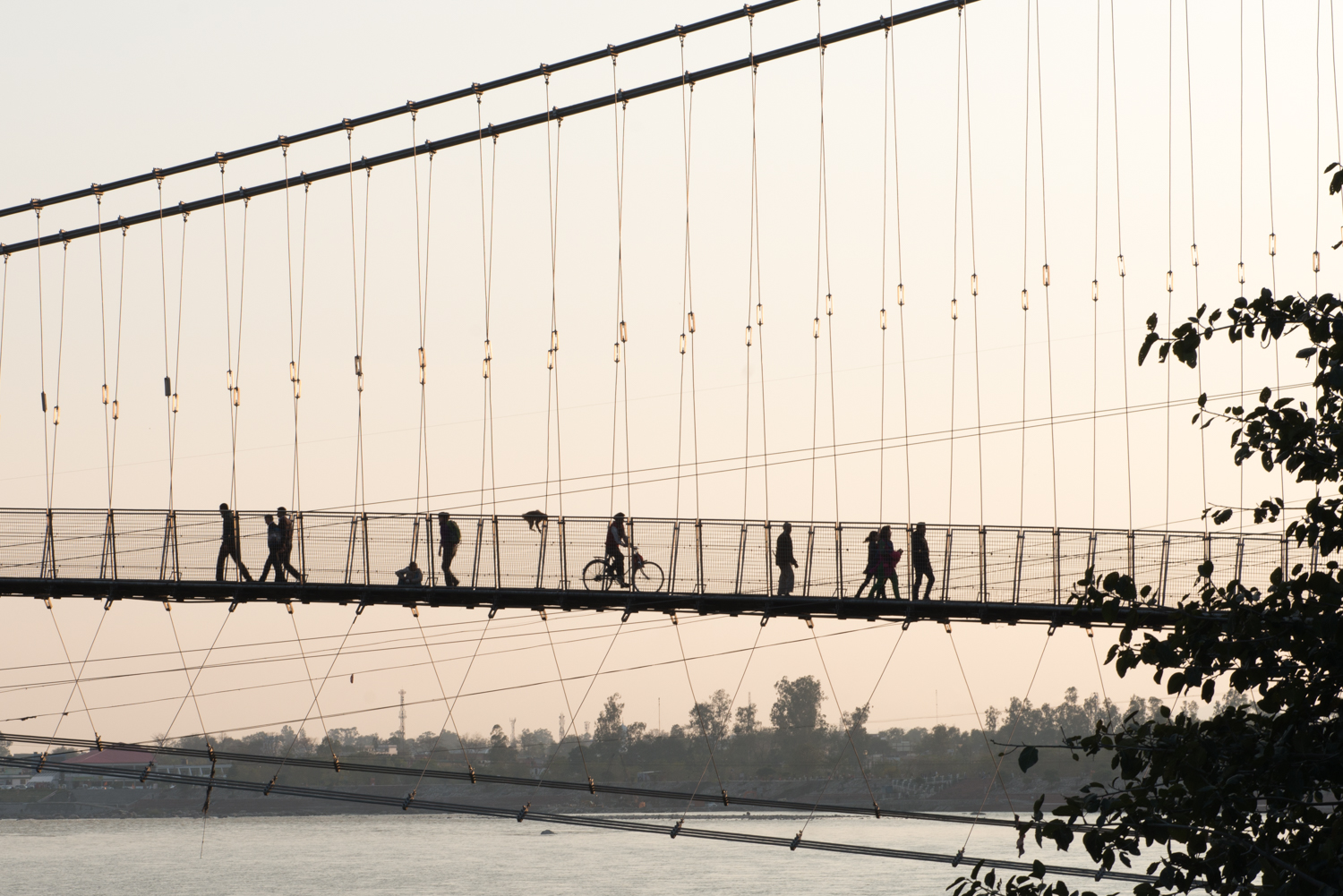 The pedestrian traffic on this bridge was ridiculous!Monkeys, bicycles,people, and motorbikes whiz across bridge at all hours of the day - Rishikesh, India.