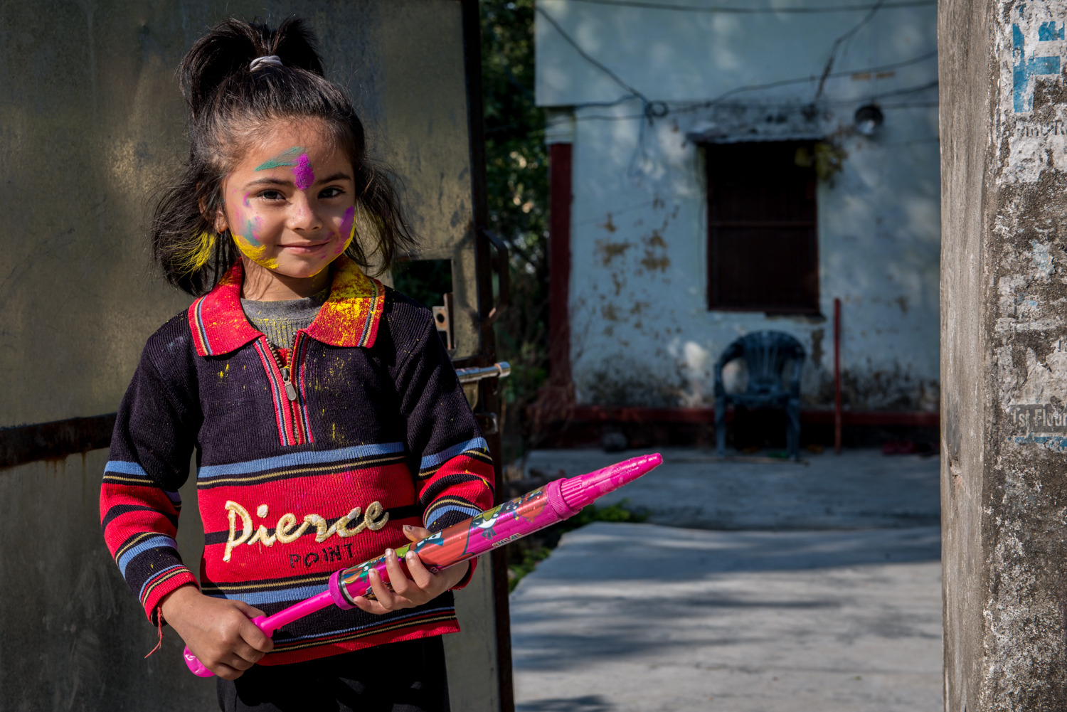 A young girl celebrates Holi festival. It is known as the festival of colours, one of the biggest festivals in India - Rishikesh, India.