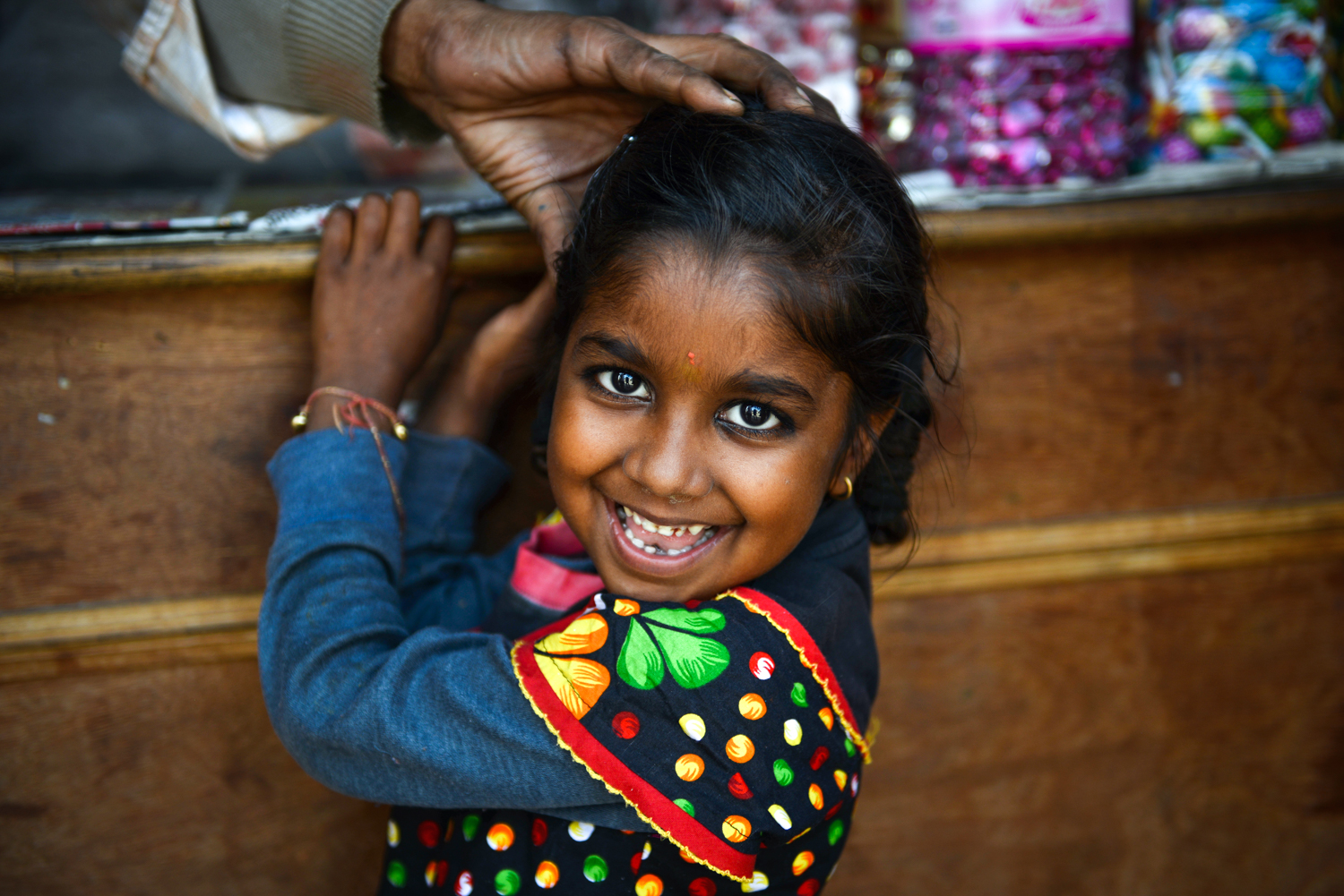 A young girl flashes a smile as I ask her about her family - Ramnagar, India.