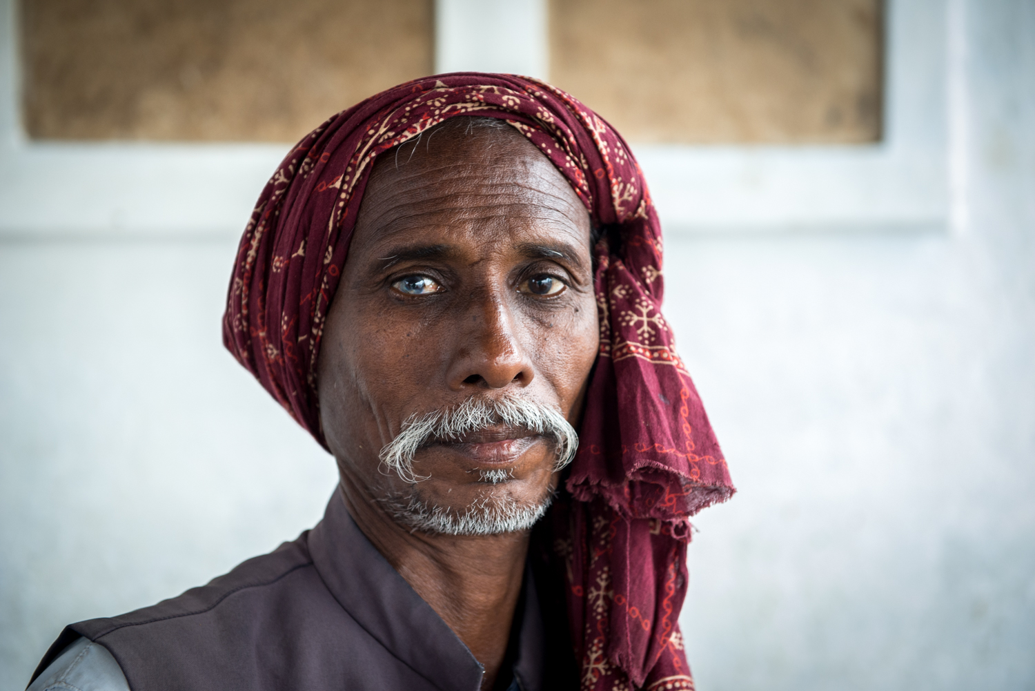 A man possessing two different coloured eyes - Varanasi, India.