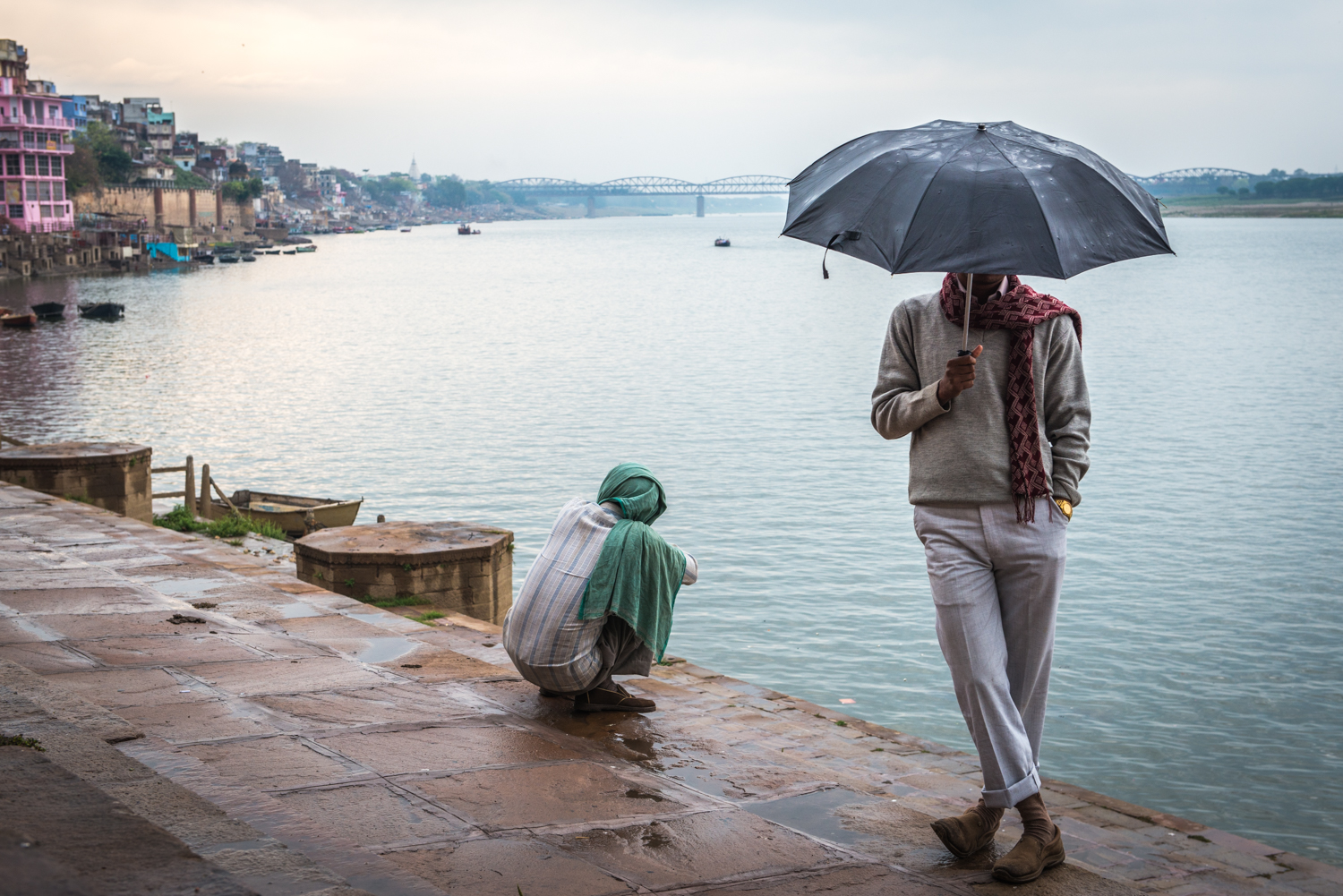 A man unknowingly poses near the banks of the Ganges river - Varanasi, India.