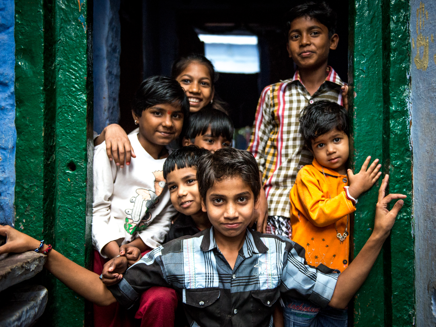 A boy in the middle creates a boundary between his family and me - Varanasi, India.