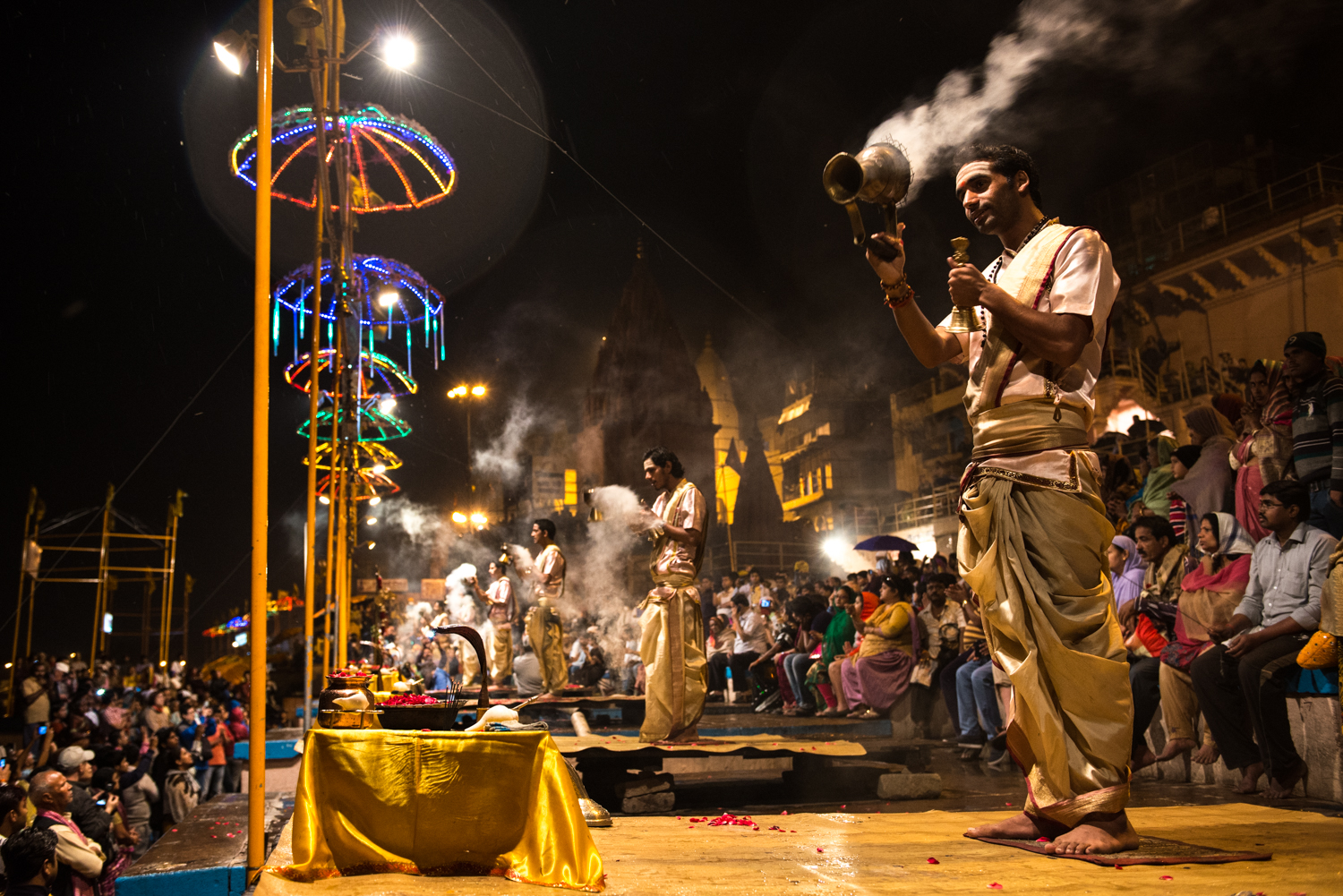Ganges Aarti is a devotional ritual that uses fire as an offering. Men dance with lamps that are lit up, accompanied with songs that praise deities - Varanasi, India.