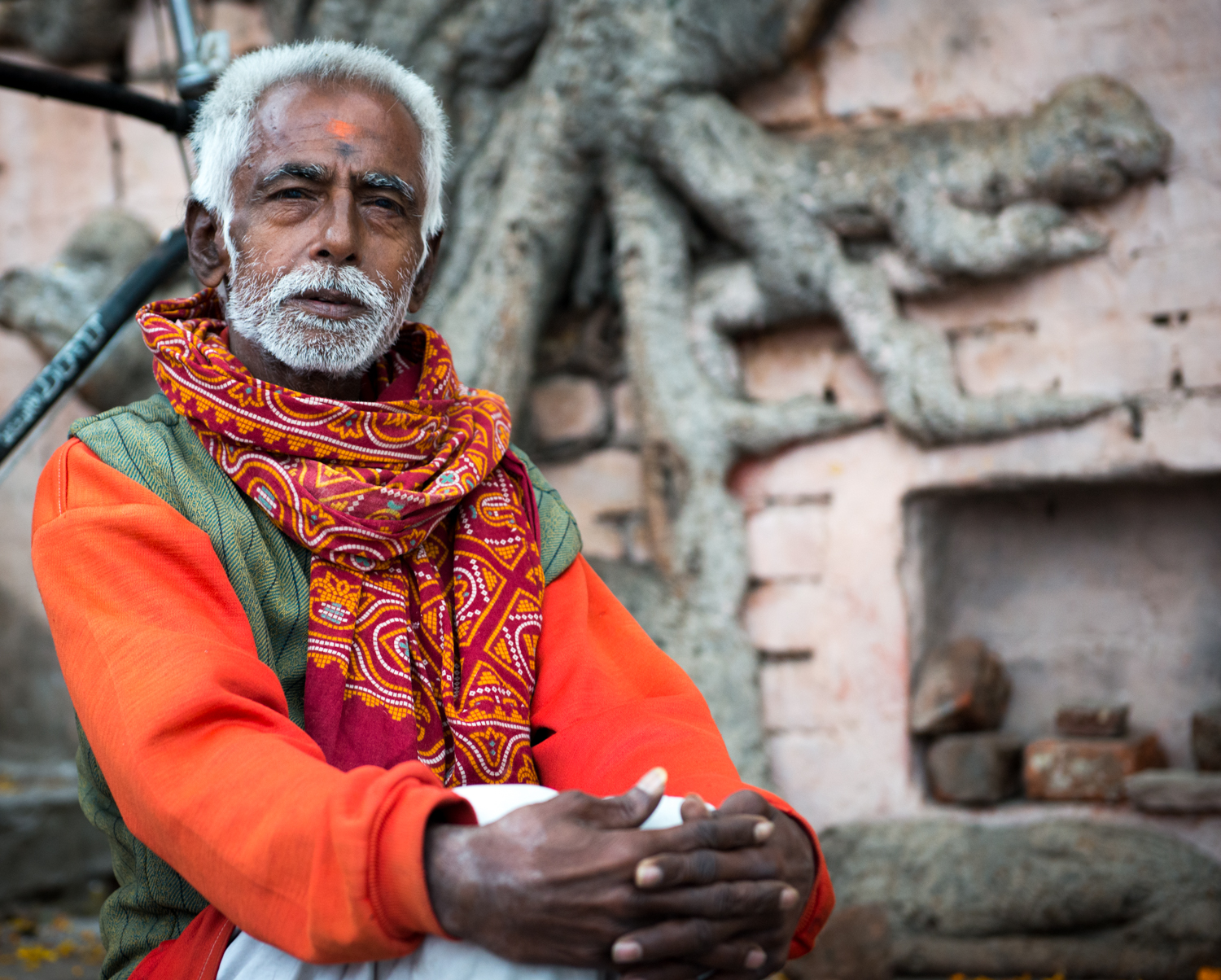 A man poses for a picture - Varanasi, India.