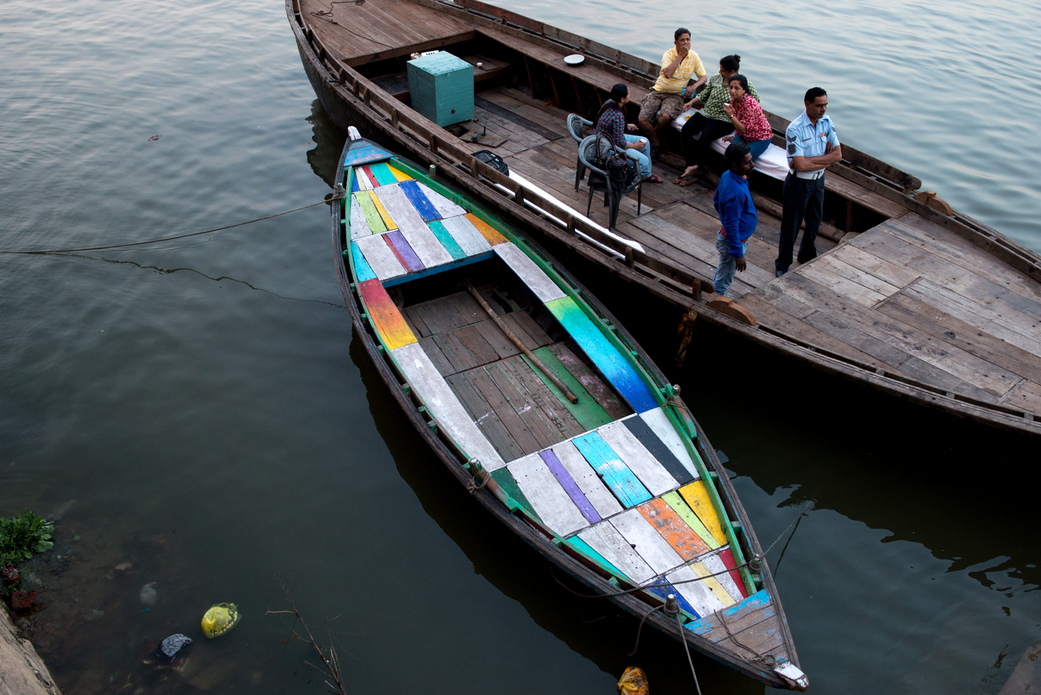 A colourful boat rests on the Ganges River - Varanasi, India.