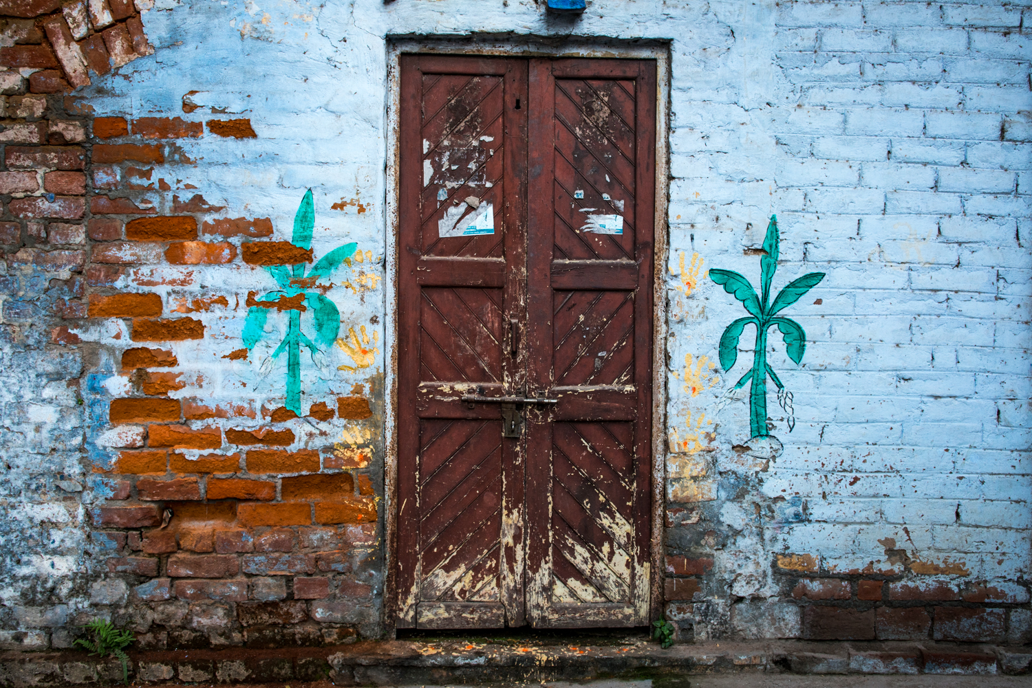 There are hundreds of doors in India that are painted with colourful interesting designs - Uttar Pradesh, India.