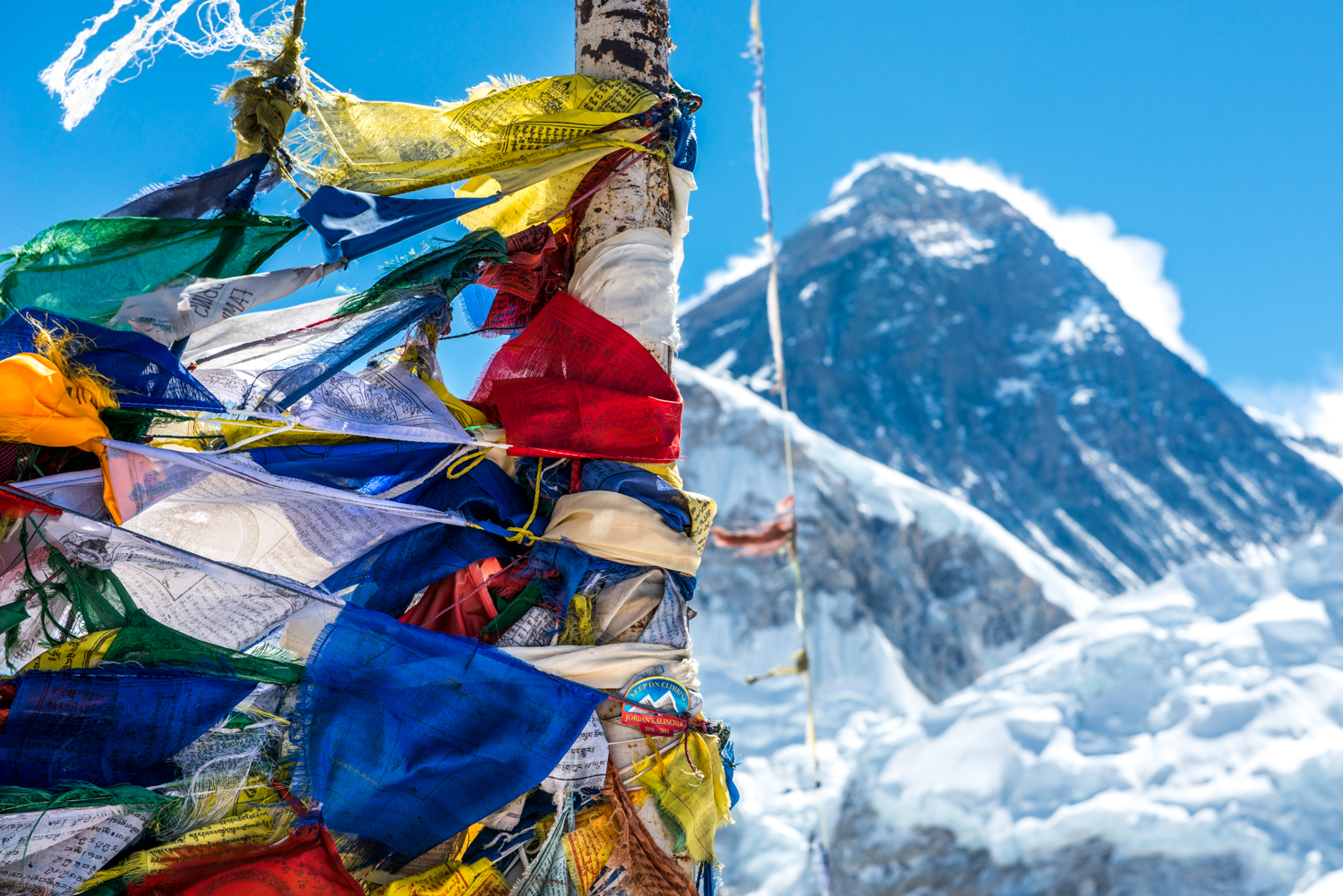 Prayer flags sway in front the of Mount Everest at the top of Kala Pattar (5545m) - Mount Everest, Nepal.
