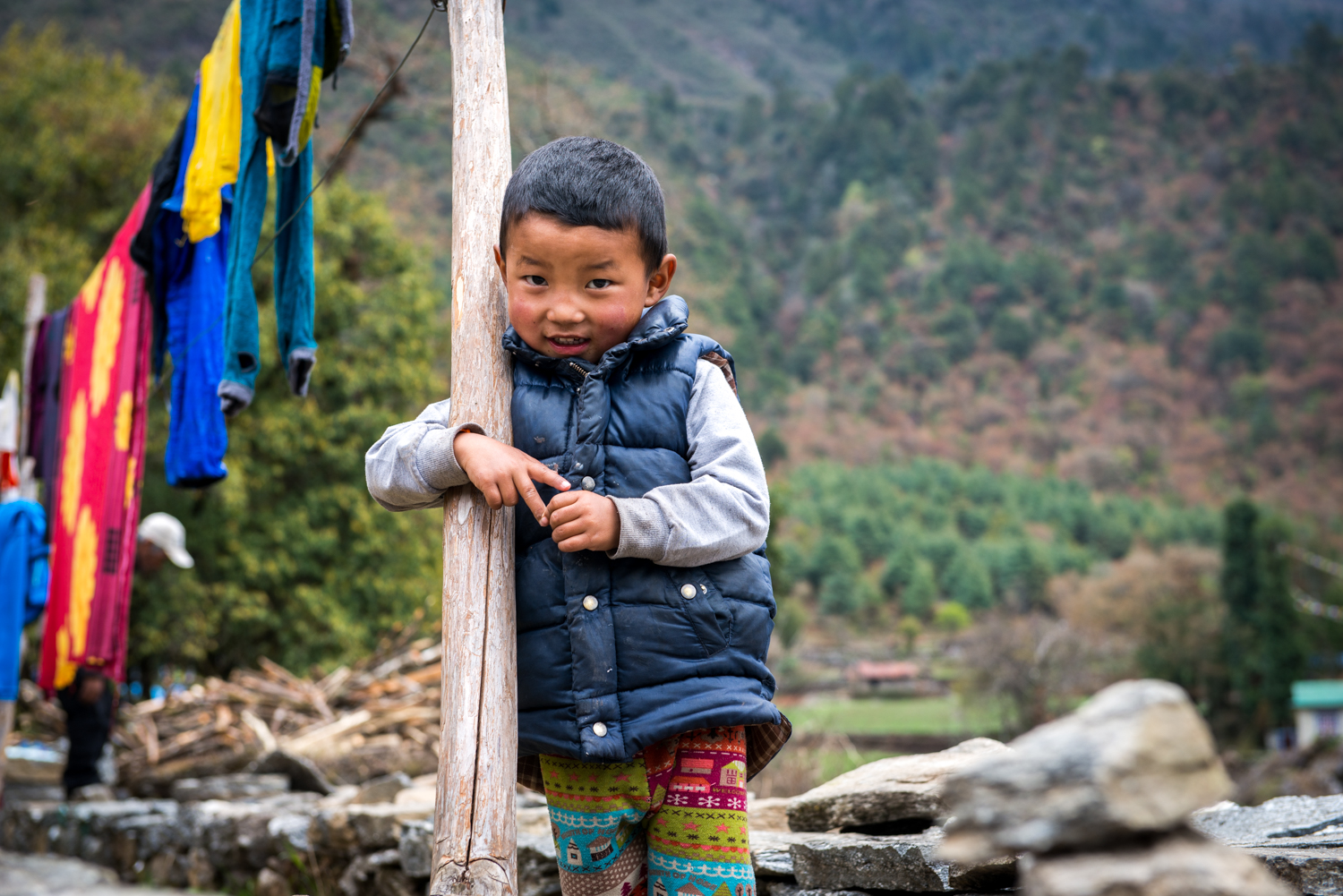 A boy shyly greets us on our descent from Everest Basecamp - Lukla, Nepal.