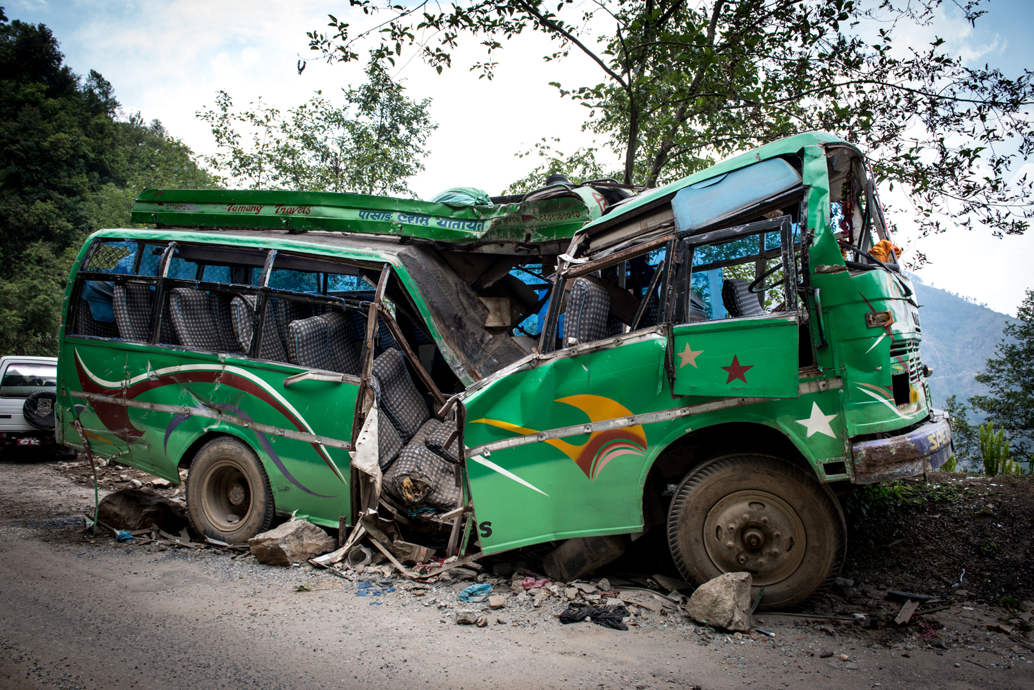 On our way driving to drop supplies off in Newakot, we came across a bus that had been hit by a rock unleashed by one of the aftershocks. Surprisingly, only 2 of the 55 passengers were killed upon impact.