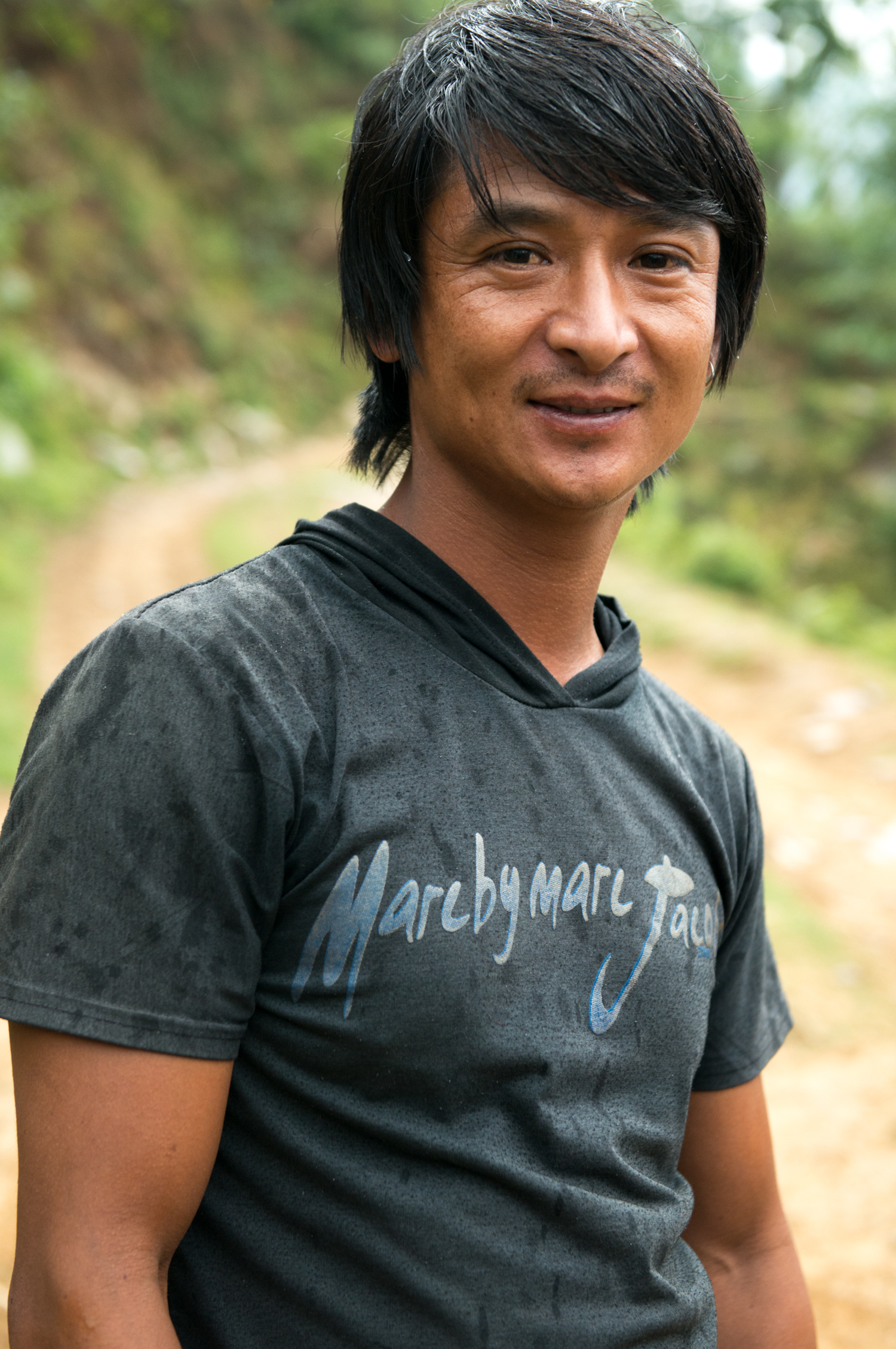 Our 'Jackie Chan' resembling driver smiled as we provided resources to his village. He drove our truck up impossible hills and roads.