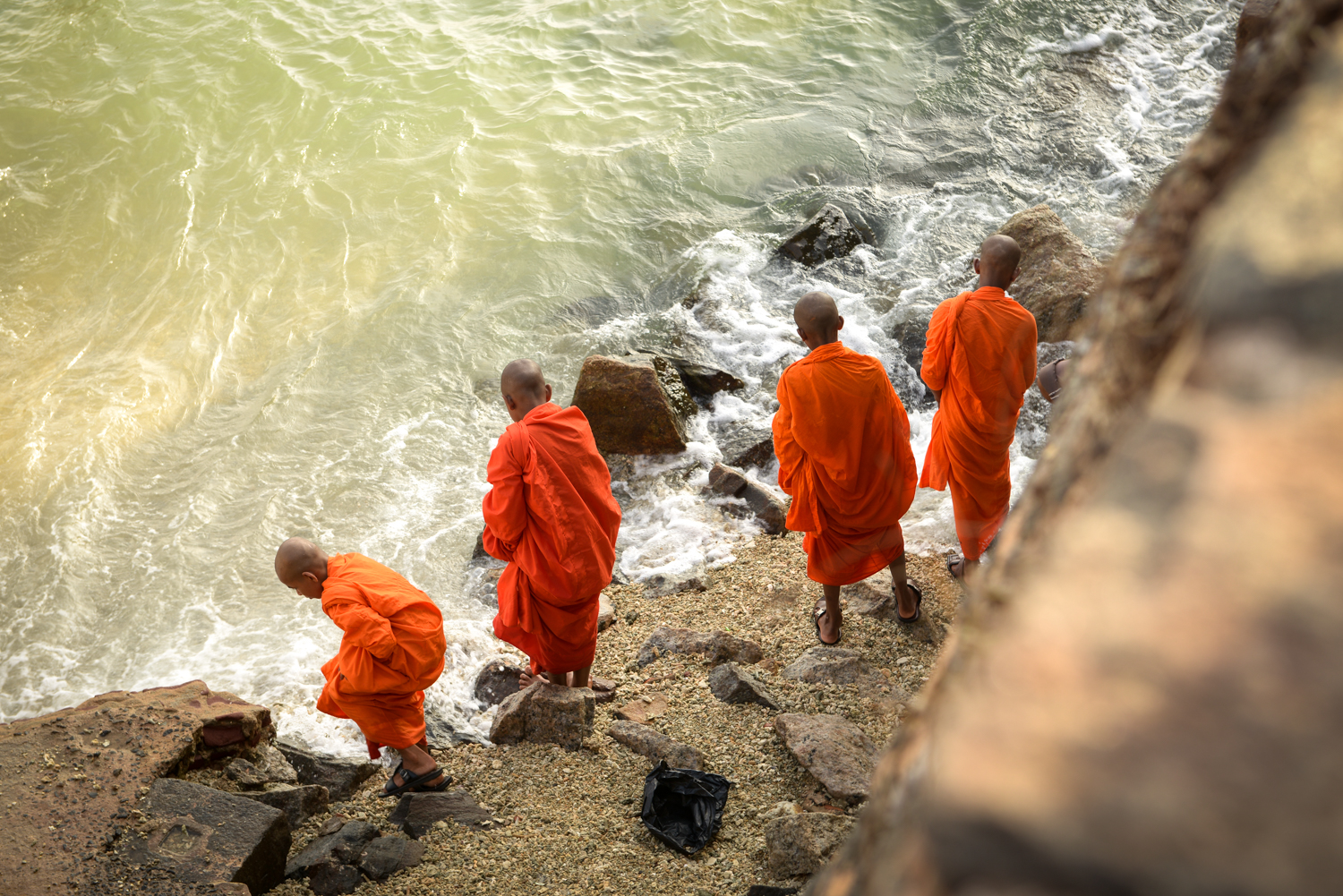 Monks play in the shores of Galle City.