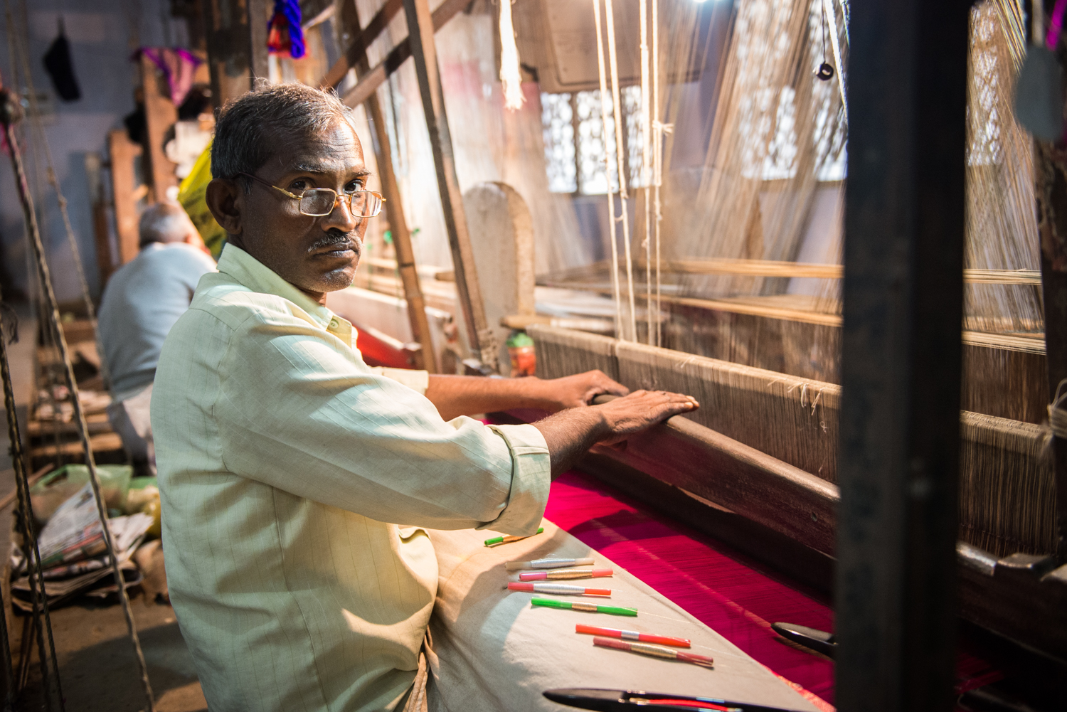 This silk weaver works 8 hours a day using the handloom and receives 400 rupees per day (8$ canadian) - Uttar Pradesh, India.