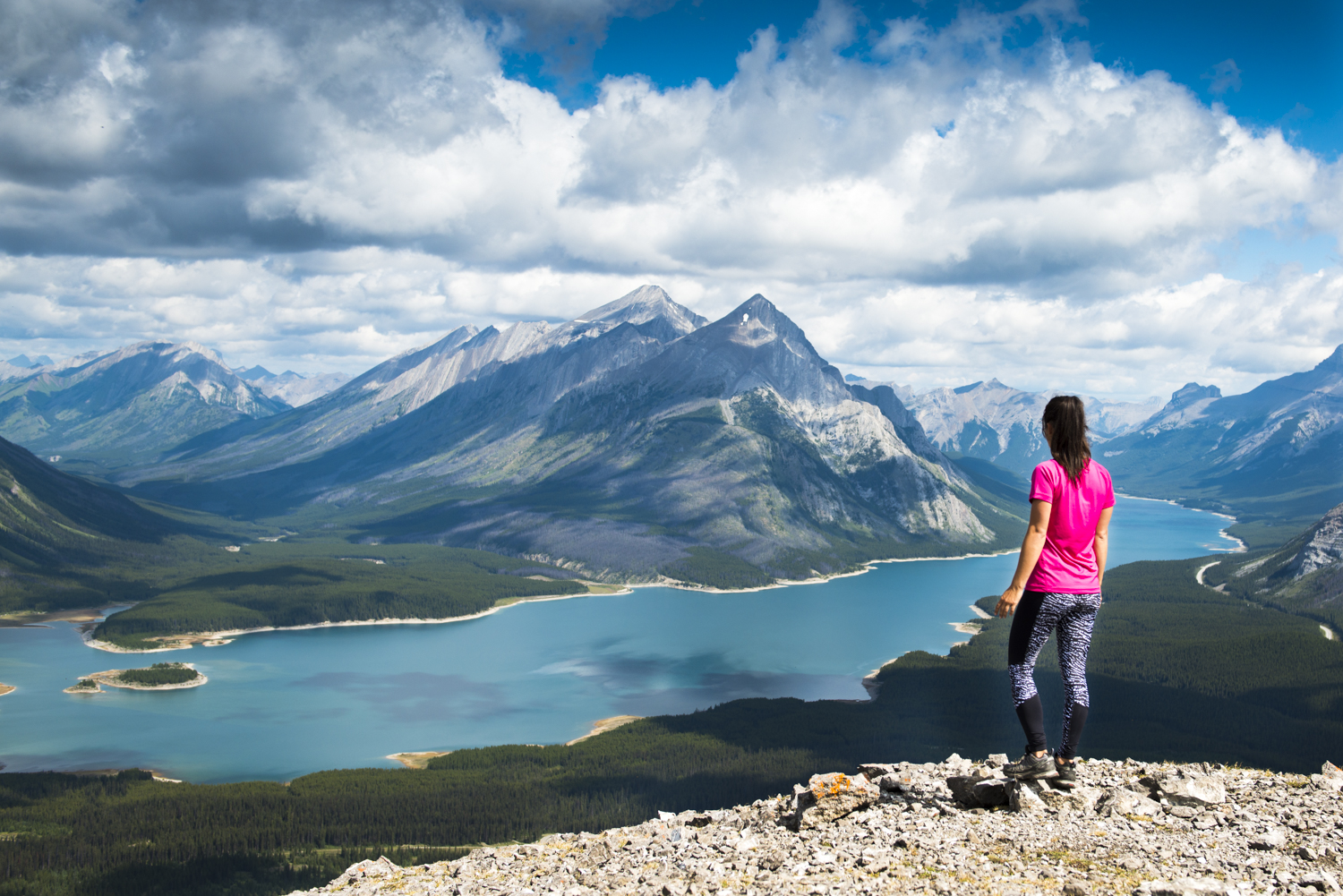 A hiker enjoys impressive views of Spray Lakes.