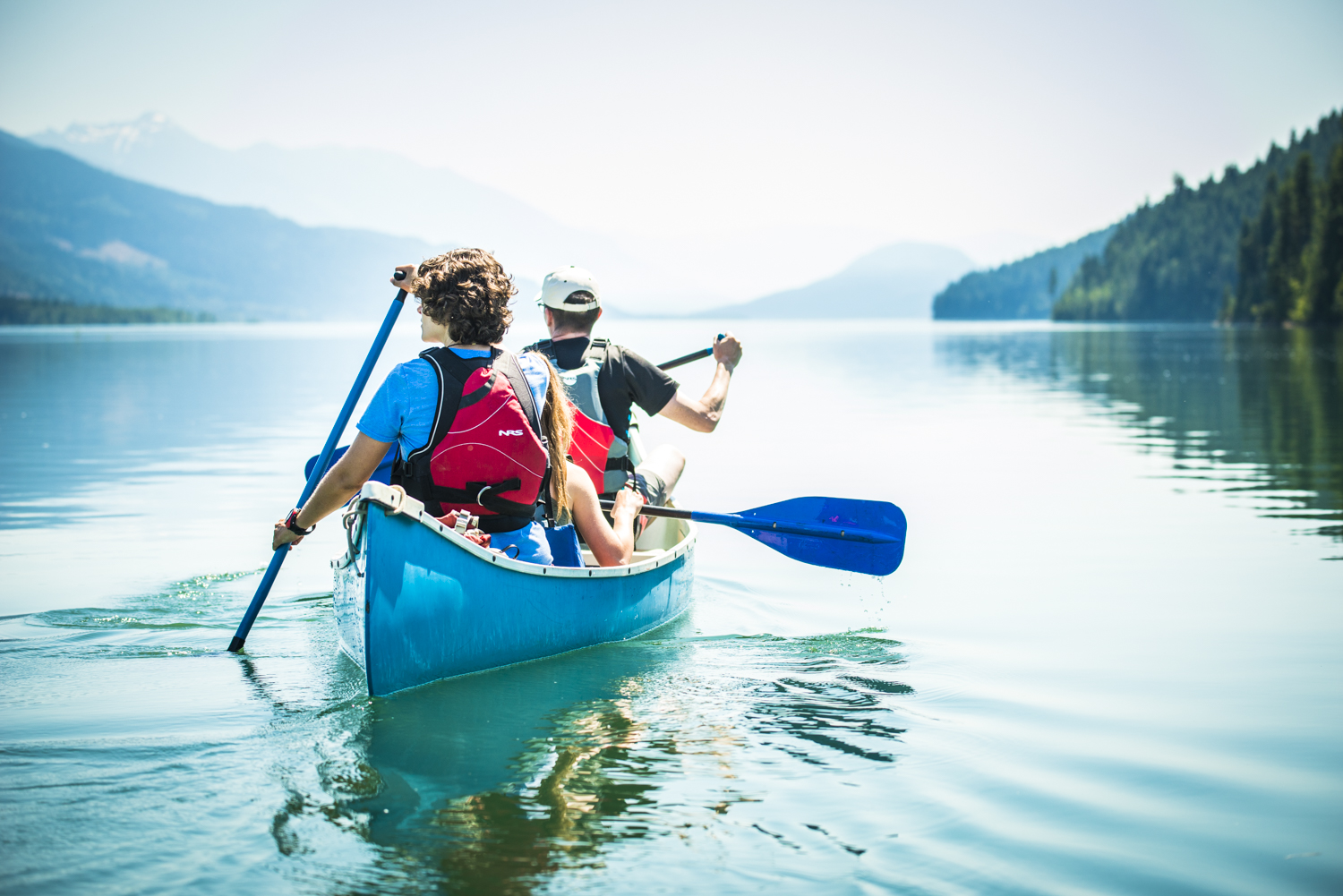people enjoy views from their canoe of the jordan river and surrounding valleys in Revelstoke, British Columbia