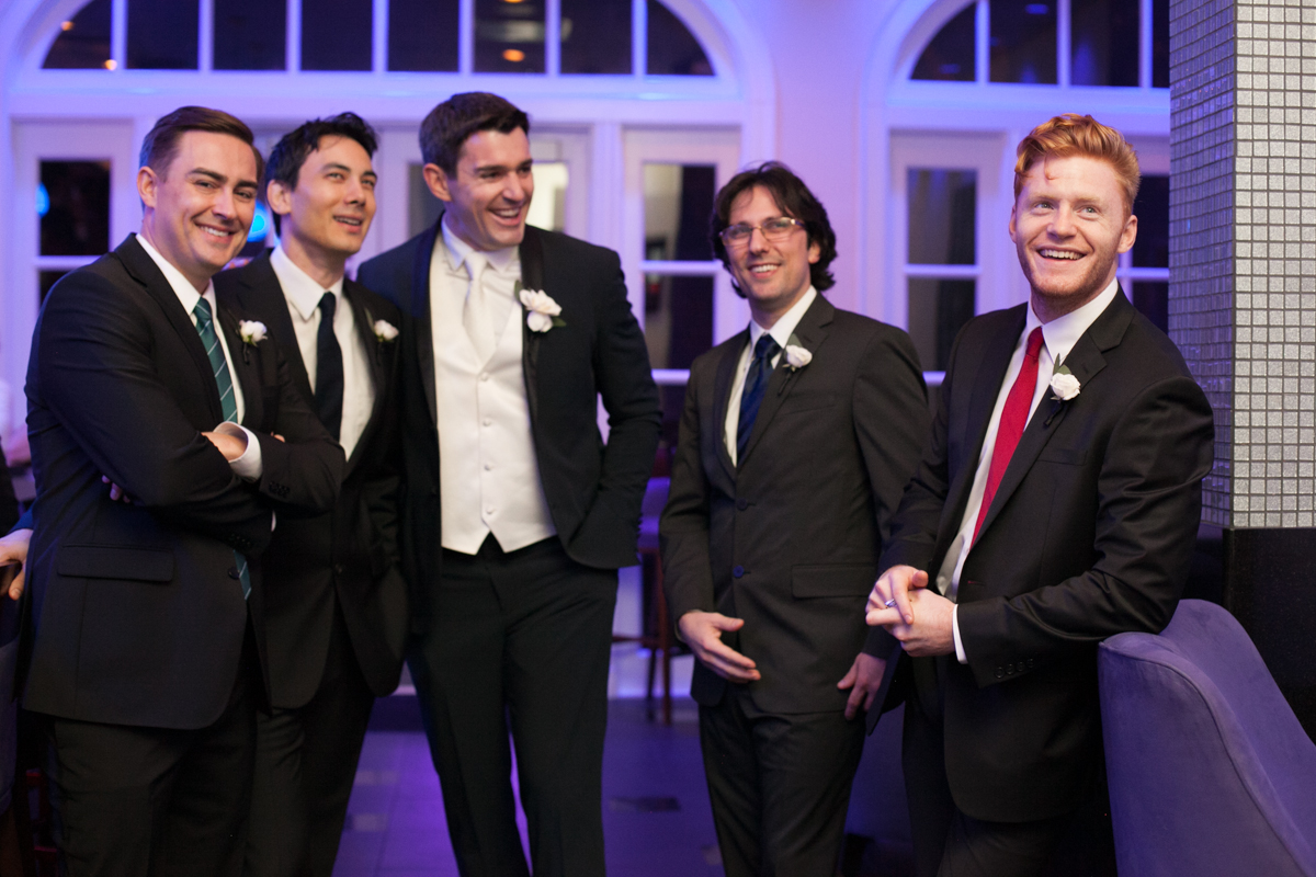 new Orleans weddings groomsmen at the bar