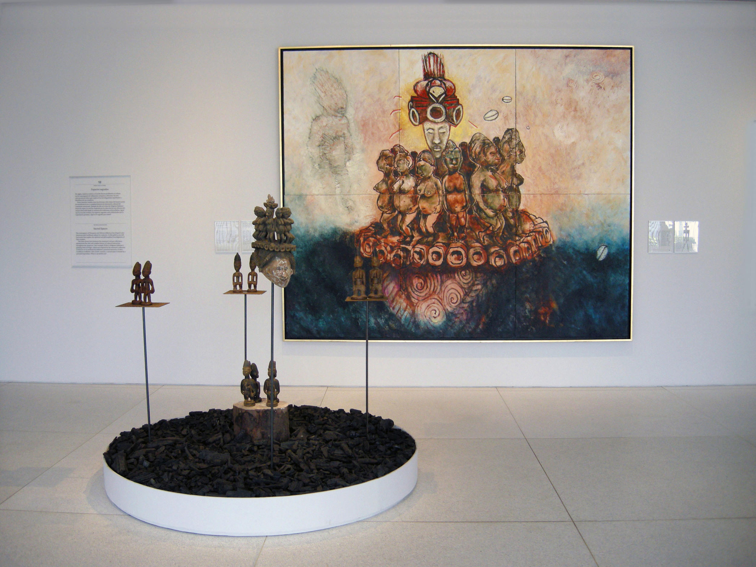 "Point of Origin, 2010, Encaustic Painting on Linen, African Wood Sculptures, Iron Stand, Circular Wood Base, Tree Trunk and Charcoal, 120"" X 120"" X 120"""