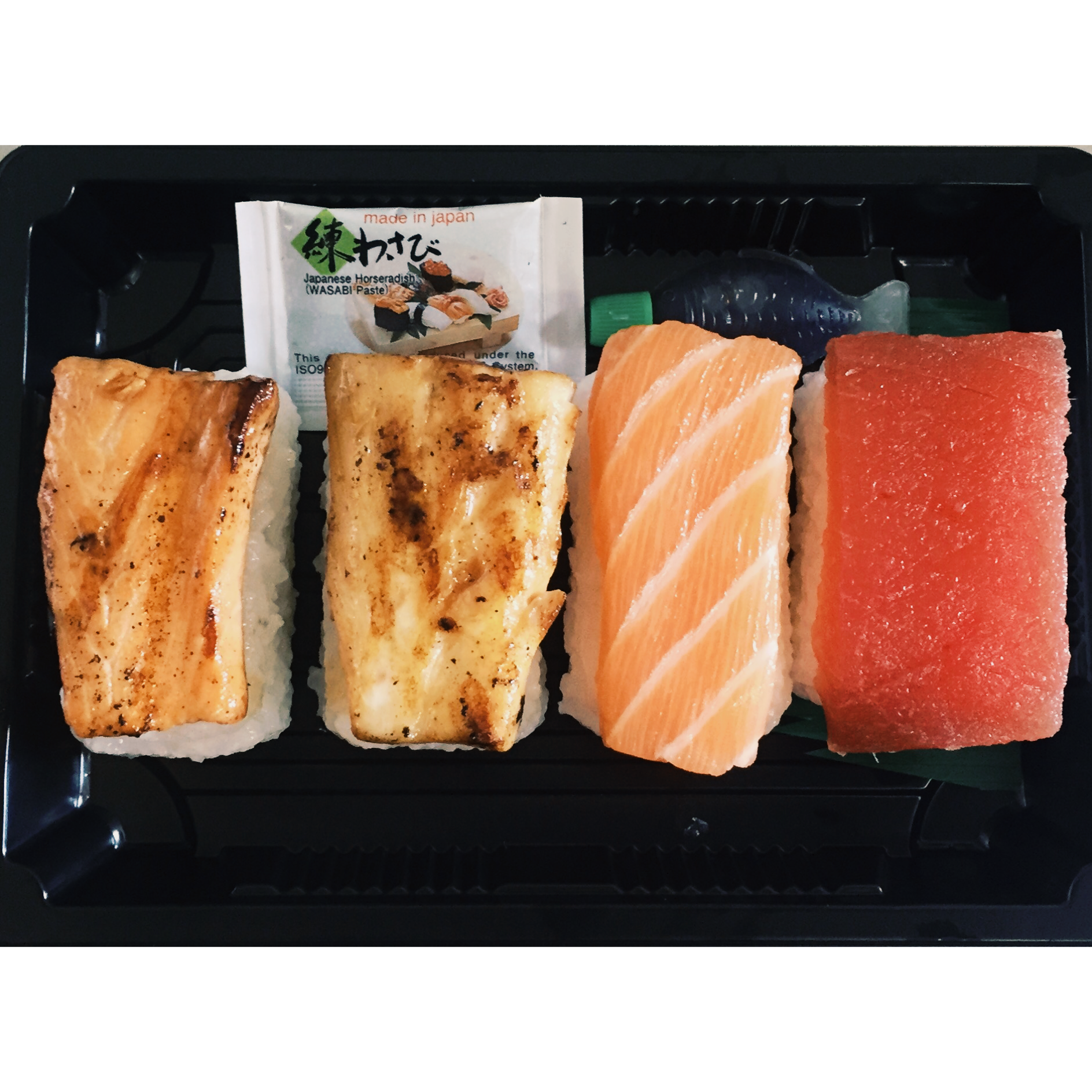 THE MIXED NIGIRI BOX - £6   2 x grilled teriyaki seabass, 2 x grilled teriyaki salmon, 2 x salmon nigiri