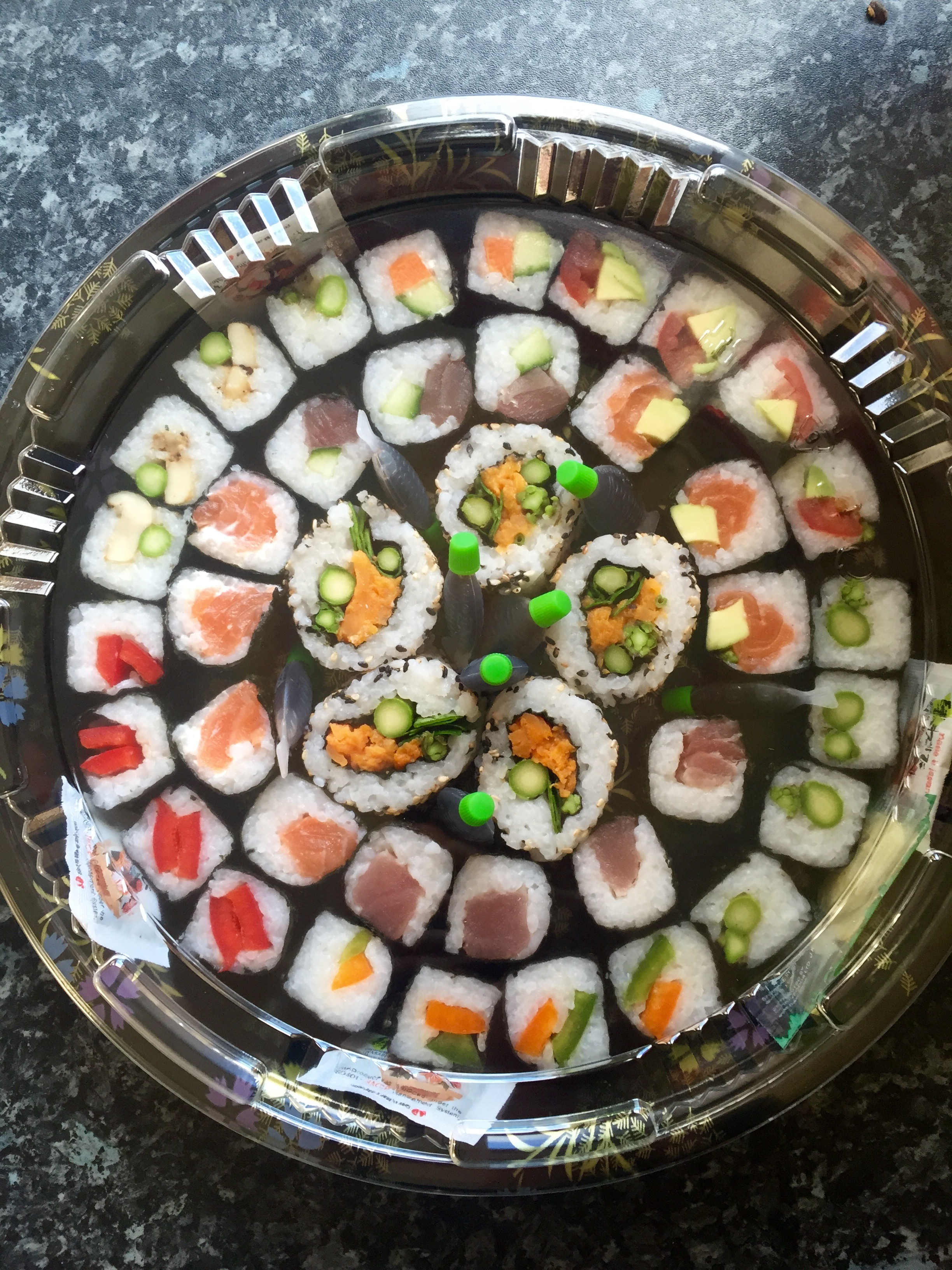 THE CLASSIC MIXED SUSHI PLATTER - £25   Includes a mix of maki rolls & inside out rolls filled with box fish and vegetarian options.