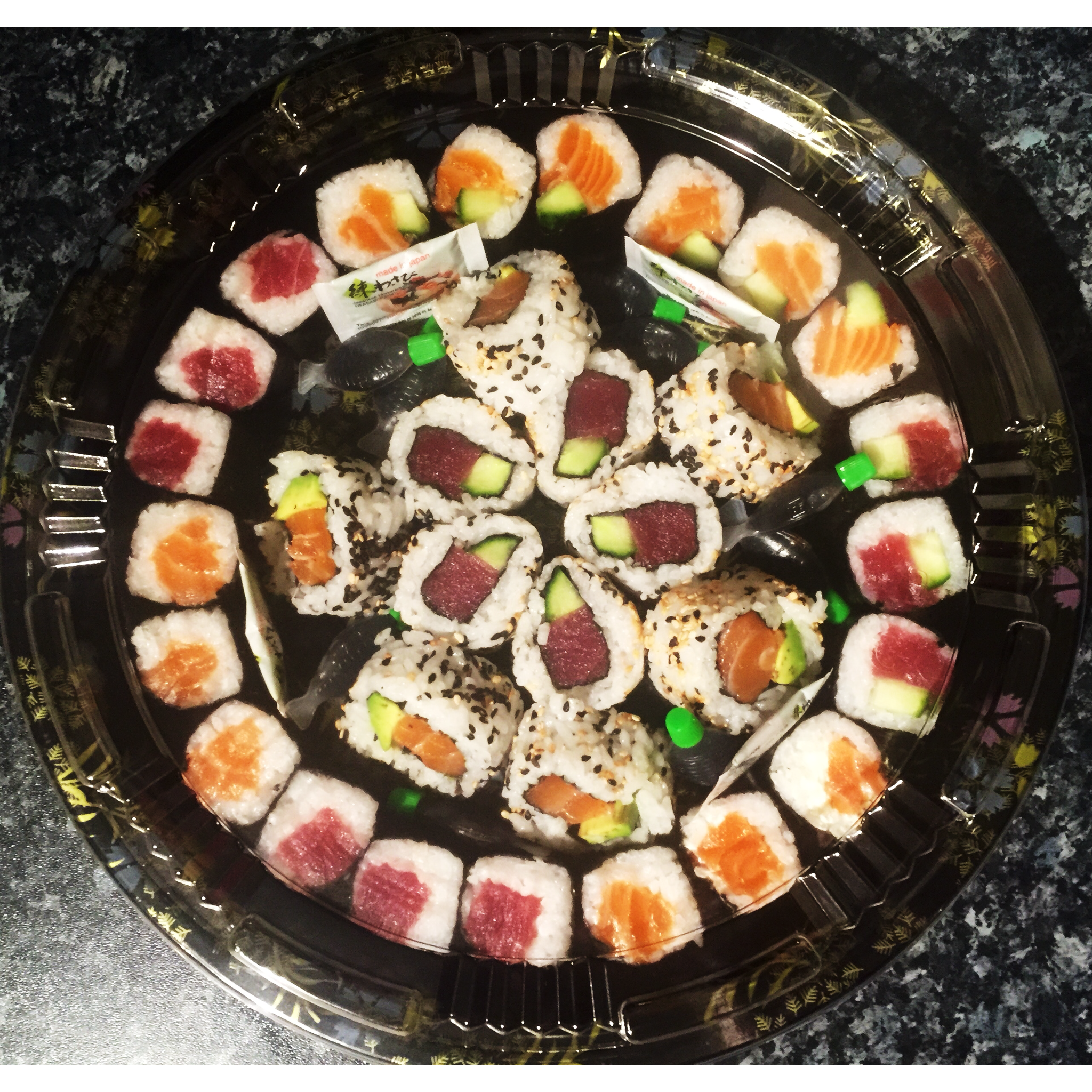 THE MINATO SHARER BOX - £35    (please note this is an old photo)   A mixture of 60 fish based maki and a salmon avocado roll and a tuna and cucumber roll