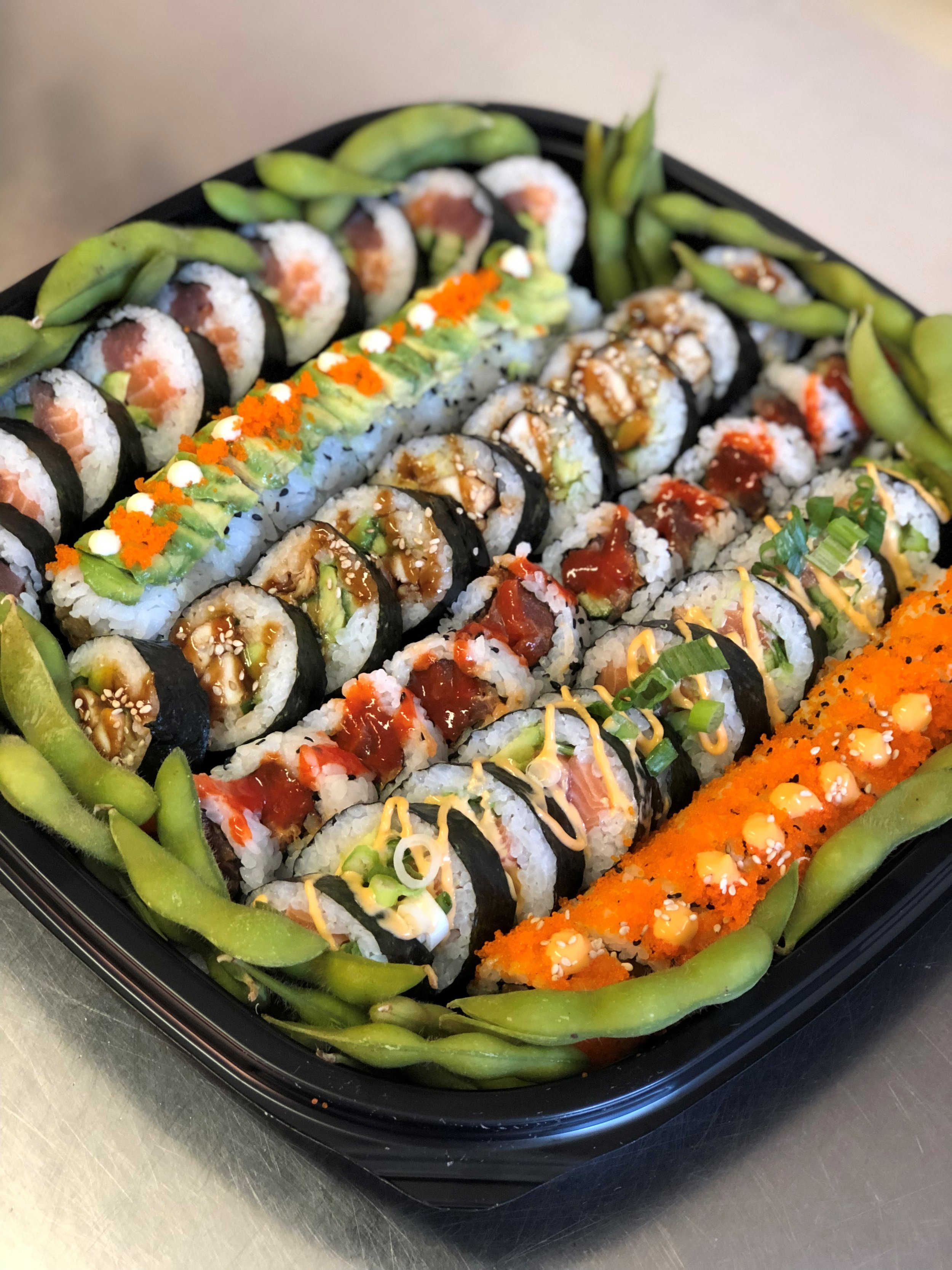 The Deluxe Futomaki Platter - £45   contains rainbow futomaki roll, deluxe caterpillar roll, chicken teriyaki futomaki, spicy tuna roll, spicy salmon roll, tobiko salmon with spicy mayo, edamame   contains gluten