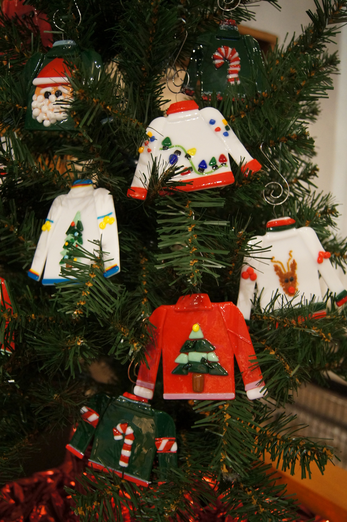 ugly sweaters on tree.JPG
