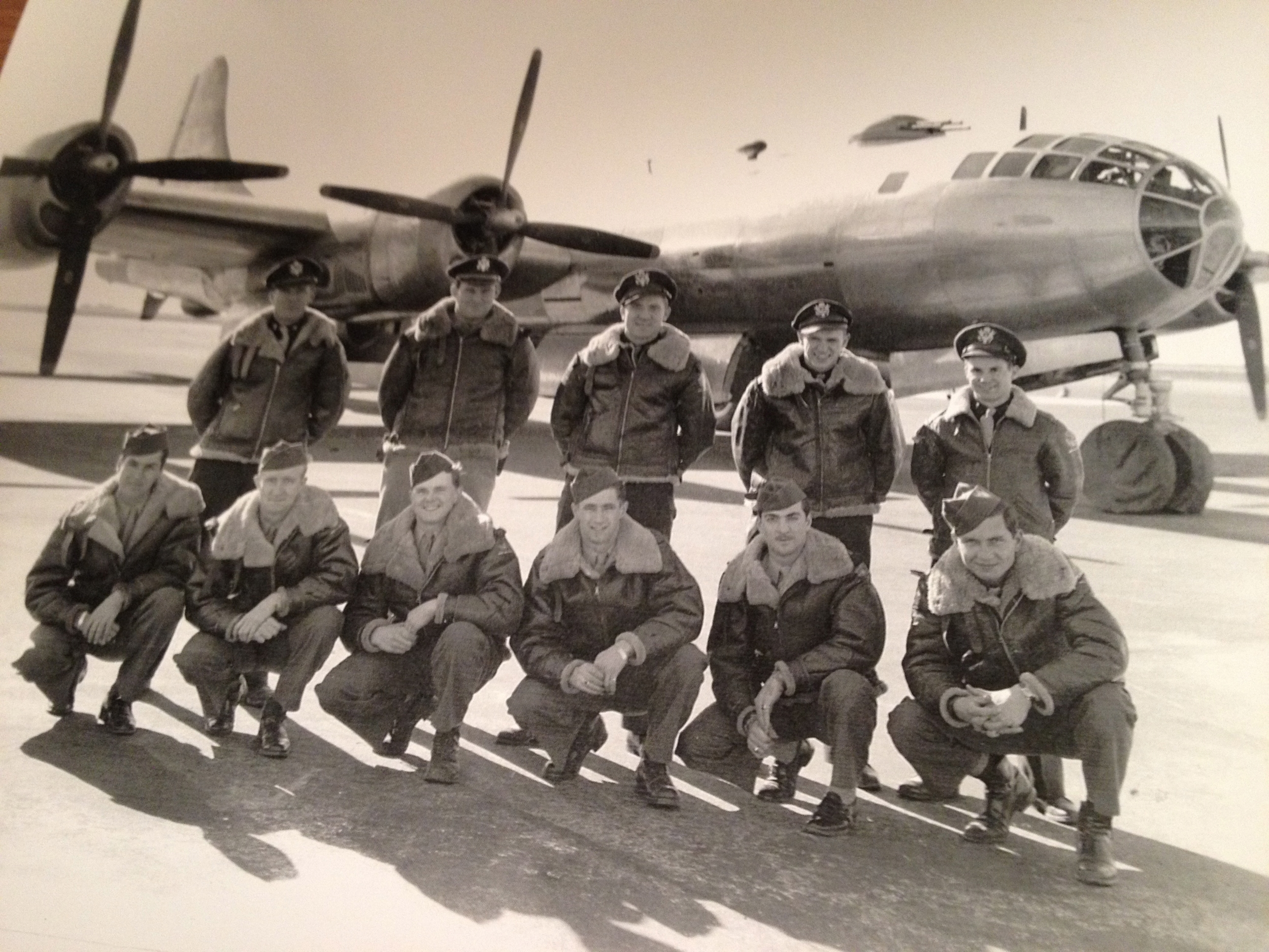 STAFF SERGEANT EDWIN HOLOPAINEN, THIRD FROM LEFT, BOTTOM ROW, WITH HIS FELLOW B-29 SUPERFORTRESS CREWMEMBERS.