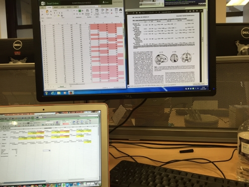 In the lab, working on analyzing data. Data entry was, by far, the longest and most tedious part of my research.