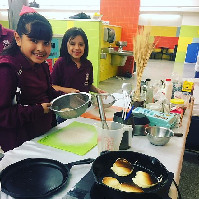 "Sweetcycle's ""Flower to Flour"" with the 4th graders at #newsettlementcmsp in the Bronx.  We husked wheat; ground wheat, cooked pancakes and porridge with the bean and germ.  #healthyfoodforkids #goodfoodforkids #wheatberries #wholegrainfoods #wheatflower"