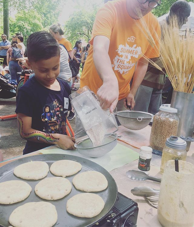 "From ""Flower to Flour"" at Union Square Park on June 1st  for ""It's My Park Day 2019"" with @unionsquareny  Sweetcycle pedalers ground up some soft winter wheat berries.  They sifted the flour; they separated the flour from the germ/bran; they shook up some pancake batter.  I cooked the kids whole wheat buttermilk pancakes with cinnamon-cardamom powdered sugar and hot cereal with fenugreek, star anise, vanilla syrup.  #freshlygroundwheat #freshmilledflour #freshmilledwholegrain #cookingwithkids #cookingworkshop"