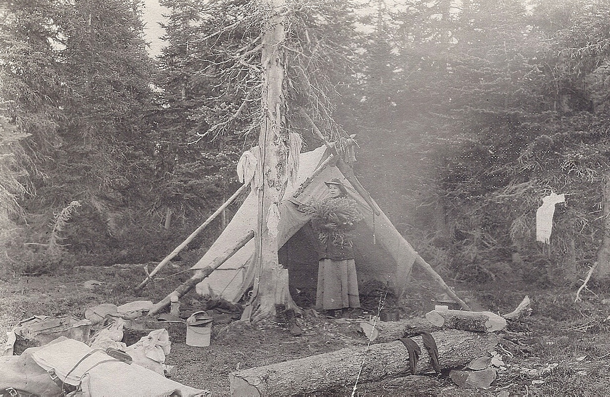 Ethel Curwood setting up camp and gathering firewood on her honeymoon in the Canadian wilderness with James Oliver Curwood.