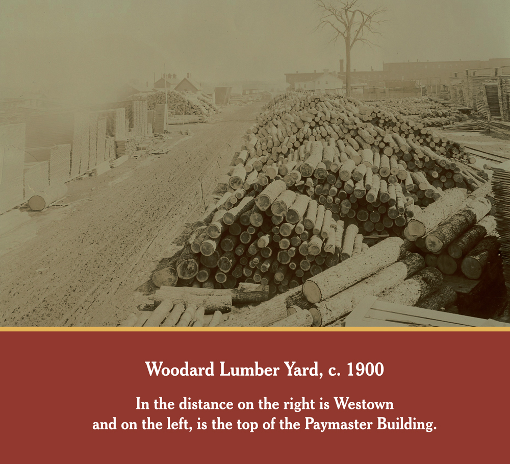 LUMBER YARD: This photo of the Woodard Lumber yard is from 1900. In the distance on the right is Westown in Owosso and on the left, is the top of the Paymaster Building.